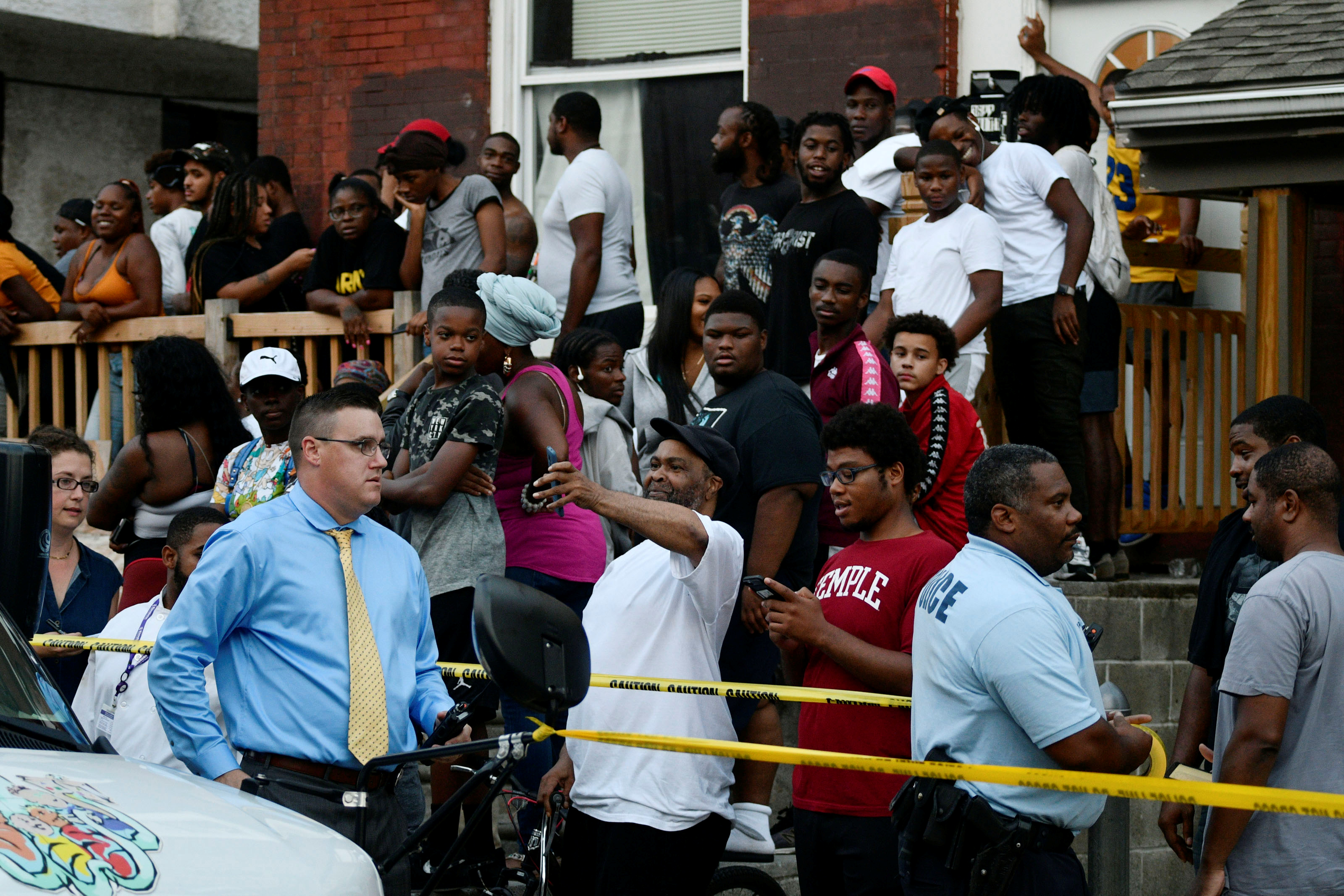 People gather during an active shooter situation, where Philadelphia police officers were shot during a drug raid on a home, in Philadelphia, Pennsylvania, U.S. August 14, 2019. REUTERS/Bastiaan Slabbers