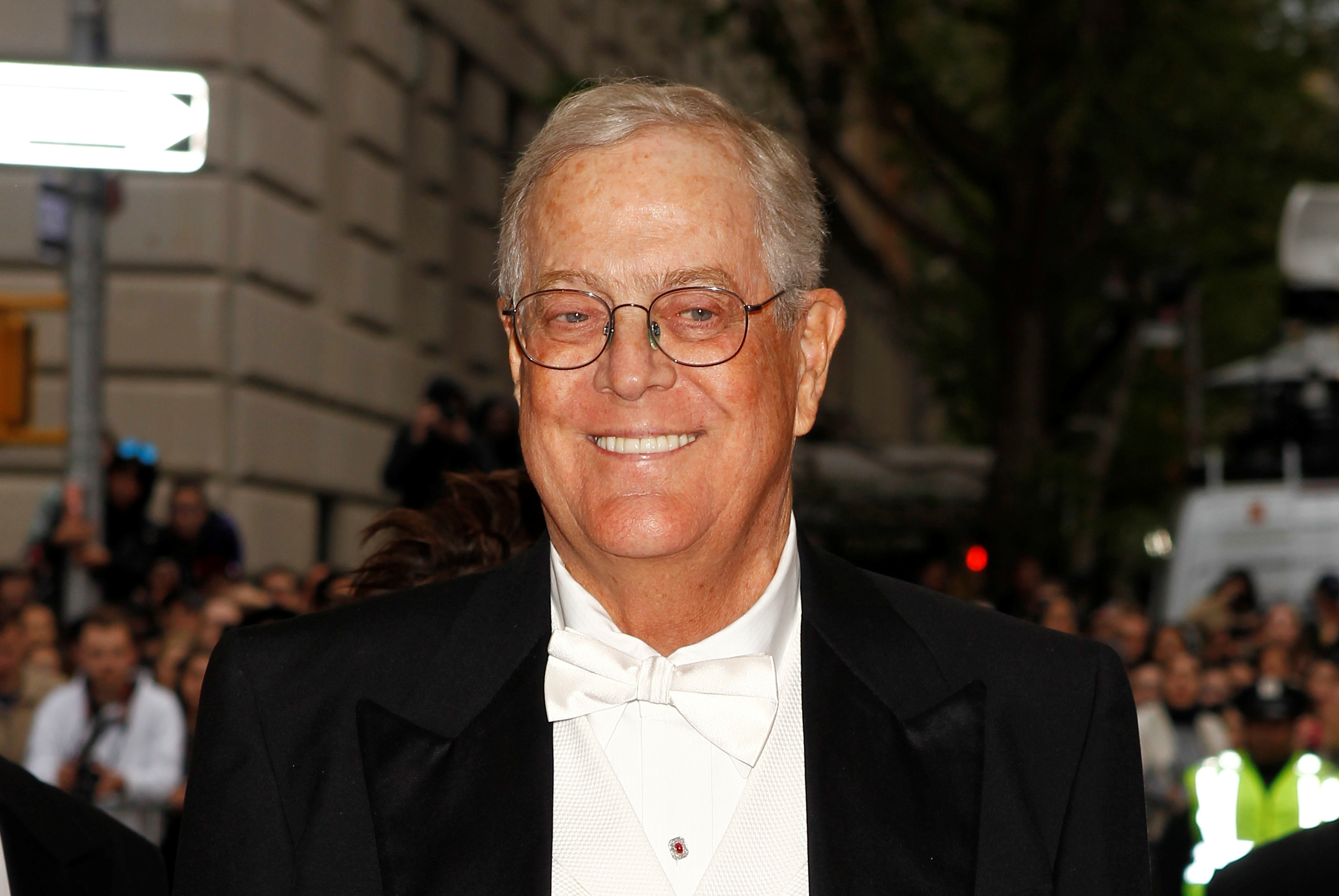 "FILE PHOTO: Businessman David Koch arrives at the Metropolitan Museum of Art Costume Institute Gala Benefit celebrating the opening of ""Charles James: Beyond Fashion"" in Upper Manhattan, New York May 5, 2014. REUTERS/Carlo Allegri/File Photo - RC13634239C0"