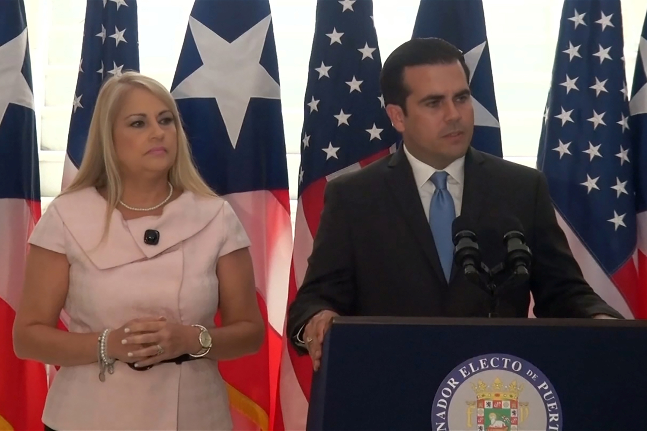 Puerto Rico's Secretary of Justice Wanda Vazquez stands next to Governor Ricardo Rossello during a news conference in an undated still image from file video in San Juan, Puerto Rico. Courtesy WIPR NOTISEIS via REUTERS