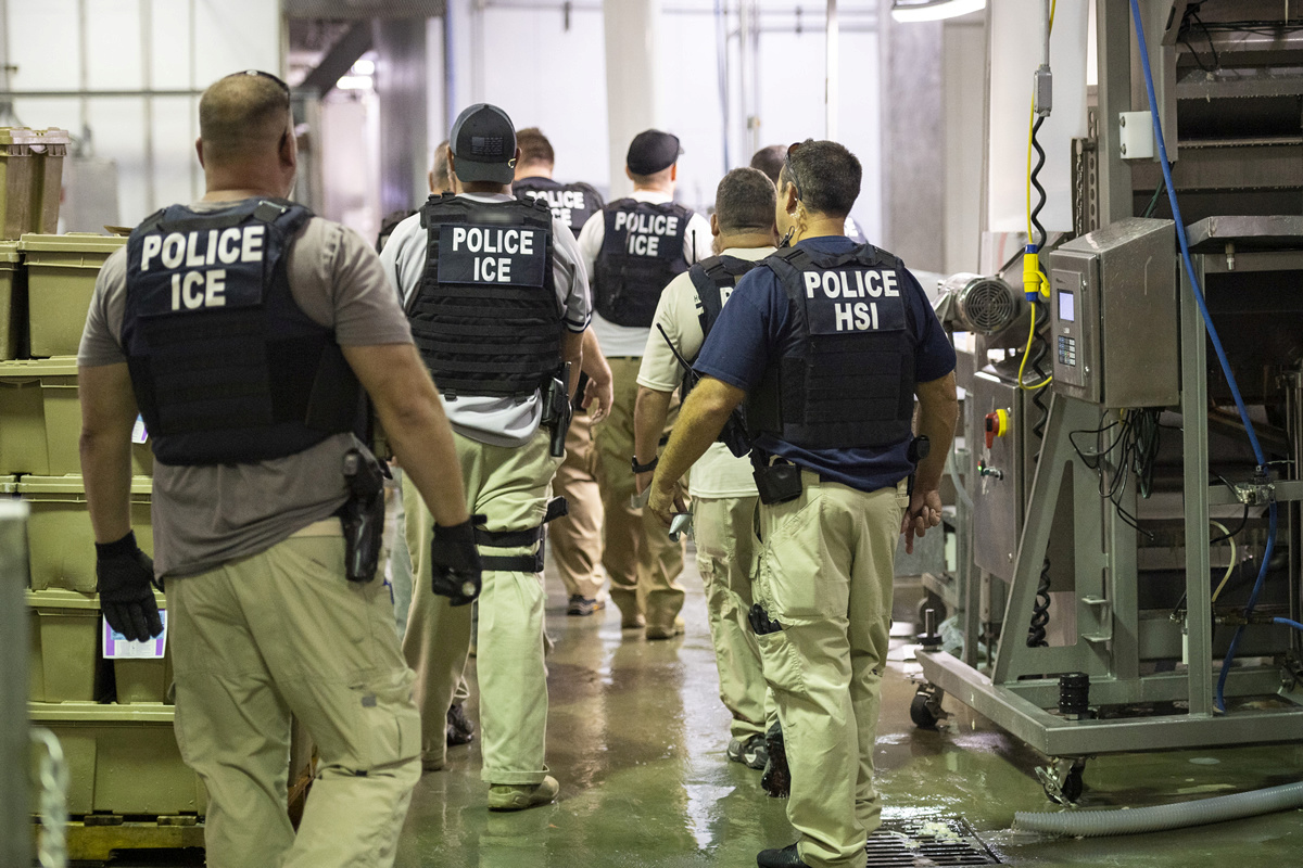 Homeland Security Investigations (HSI) officers from Immigration and Customs Enforcement (ICE) look on after executing search warrants and making some arrests at an agricultural processing facility in Canton, Mississippi. (Immigration and Customs Enforcement/Handout/Reuters)