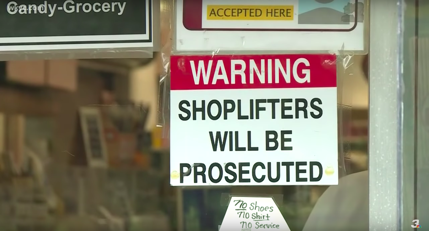 """A sign now hangs on the front of Gibson's bakery that says """"Warning: Shoplifters will be prosecuted."""" (Youtube/WKYC Channel 3)"""