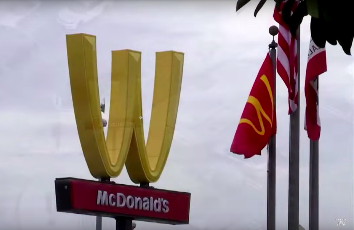 A McDonald's sign is flipped upside down for International Women's Day. (Youtube/Inside Edition)