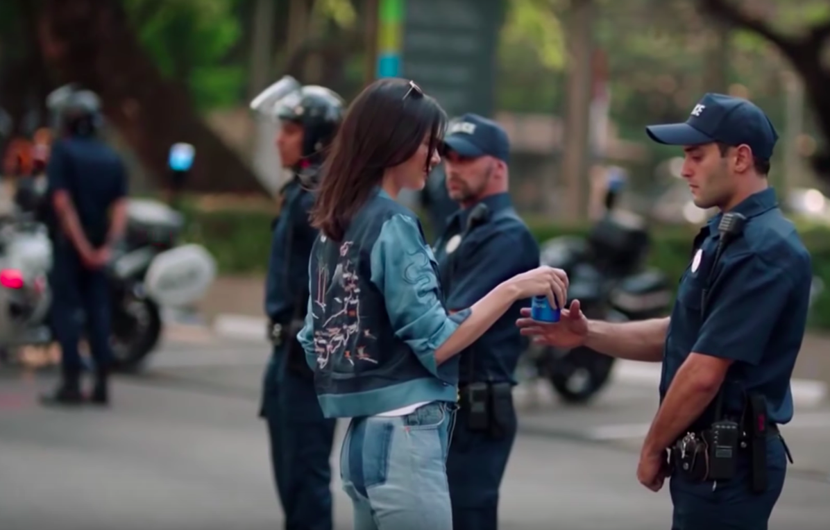 Kendall Jenner hands a police officer a Pepsi in an Pepsi commercial that borrowed imagery from Black Lives Matter protests. (Wall Street Journal/Pepsi/Youtube)