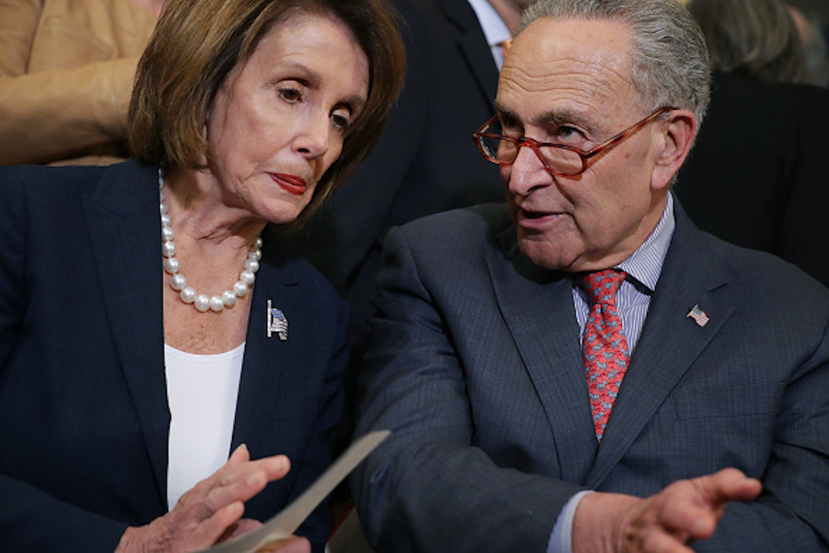 WASHINGTON, DC - MAY 15: Speaker of the House Nancy Pelosi (D-CA) (L) and Senate Minority Leader Charles Schumer (D-NY) lead a rally and news conference ahead of a House vote on health care and prescription drug legislation in the Rayburn Room at the U.S. Capitol May 15, 2019 in Washington, DC. The bicameral group of Democrats urged Senate Majority Leader Mitch McConnell (R-KY) to bring the Strengthening Health Care and Lowering Prescription Drug Costs Act up for a vote in the Senate. (Photo by Chip Somodevilla/Getty Images)
