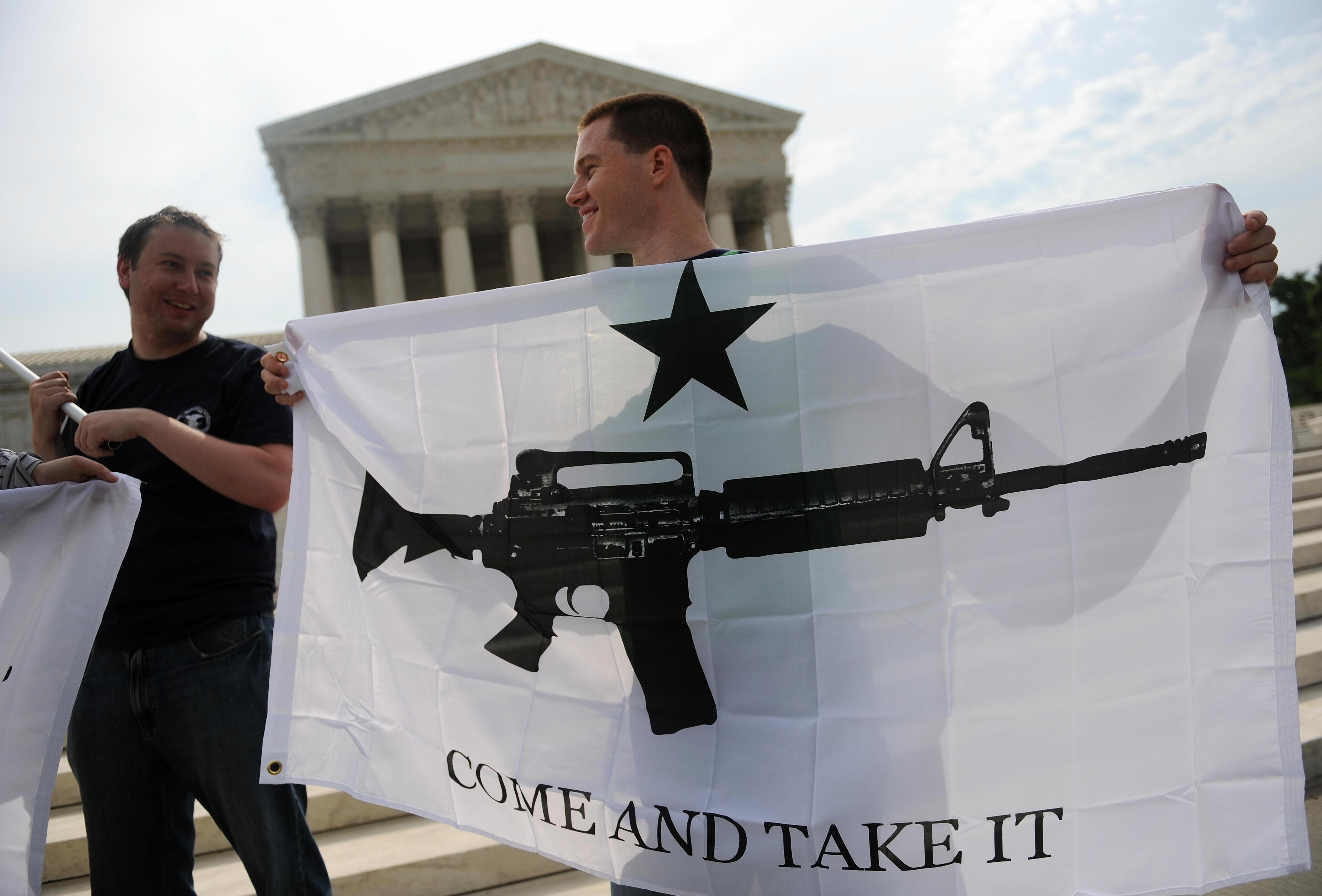 Gun rights activists celebrate the Supreme Court's D.C. v. Heller decision on June 26, 2008. (Tim Sloan/AFP/Getty Images)