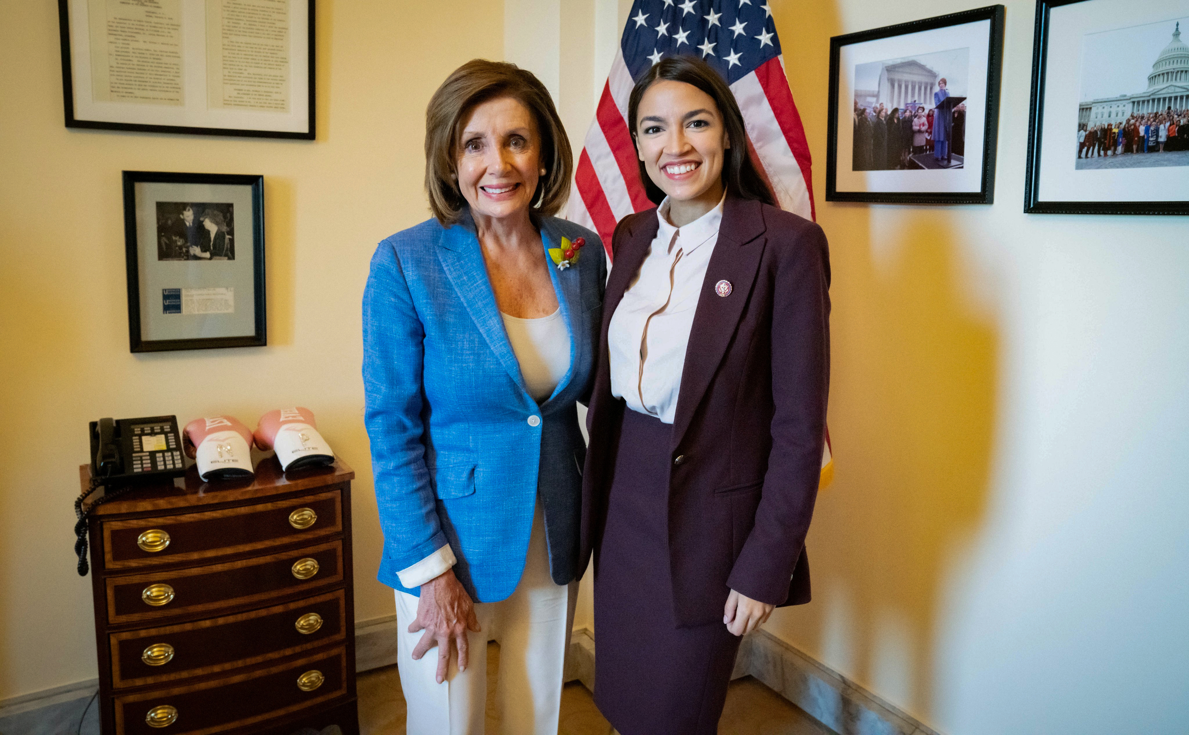 U.S. Speaker of the House Nancy Pelosi (D-CA) poses with Rep. Alexandria Ocasio-Cortez (D-NY) in a photo released by her office after they met in the Speaker's office at the U.S. Capitol in Washington, U.S. July 26, 2019. Office of House Speaker Nancy Pelosi/via REUTERS