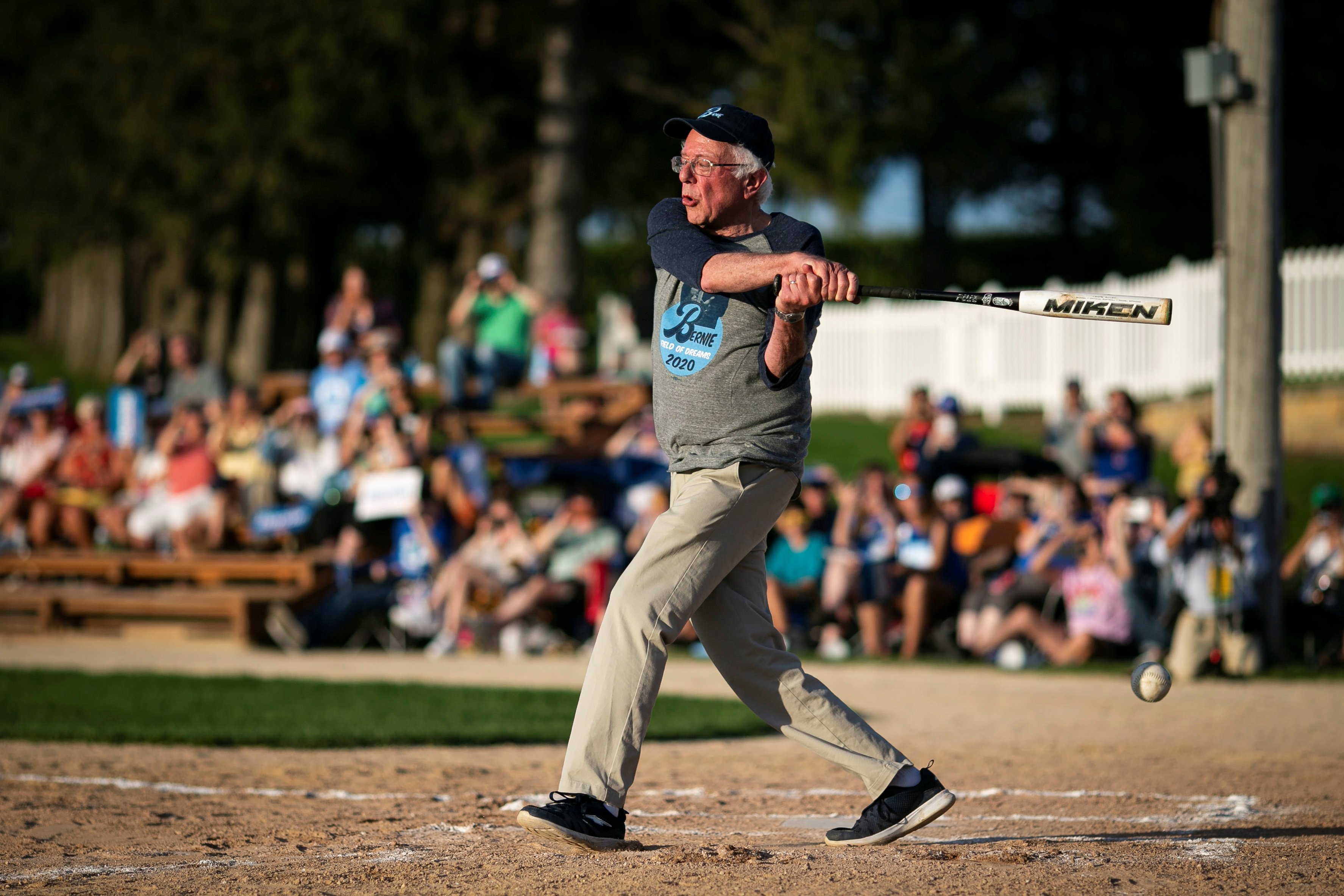 "2020 Democratic U.S. presidential candidate and U.S. Senator Bernie Sanders pitches during a baseball game between his staff, ""The Revolutionaries,"" and the Leaders Believers Achievers Foundation. U.S., August 19, 2019. REUTERS/Al Drago"
