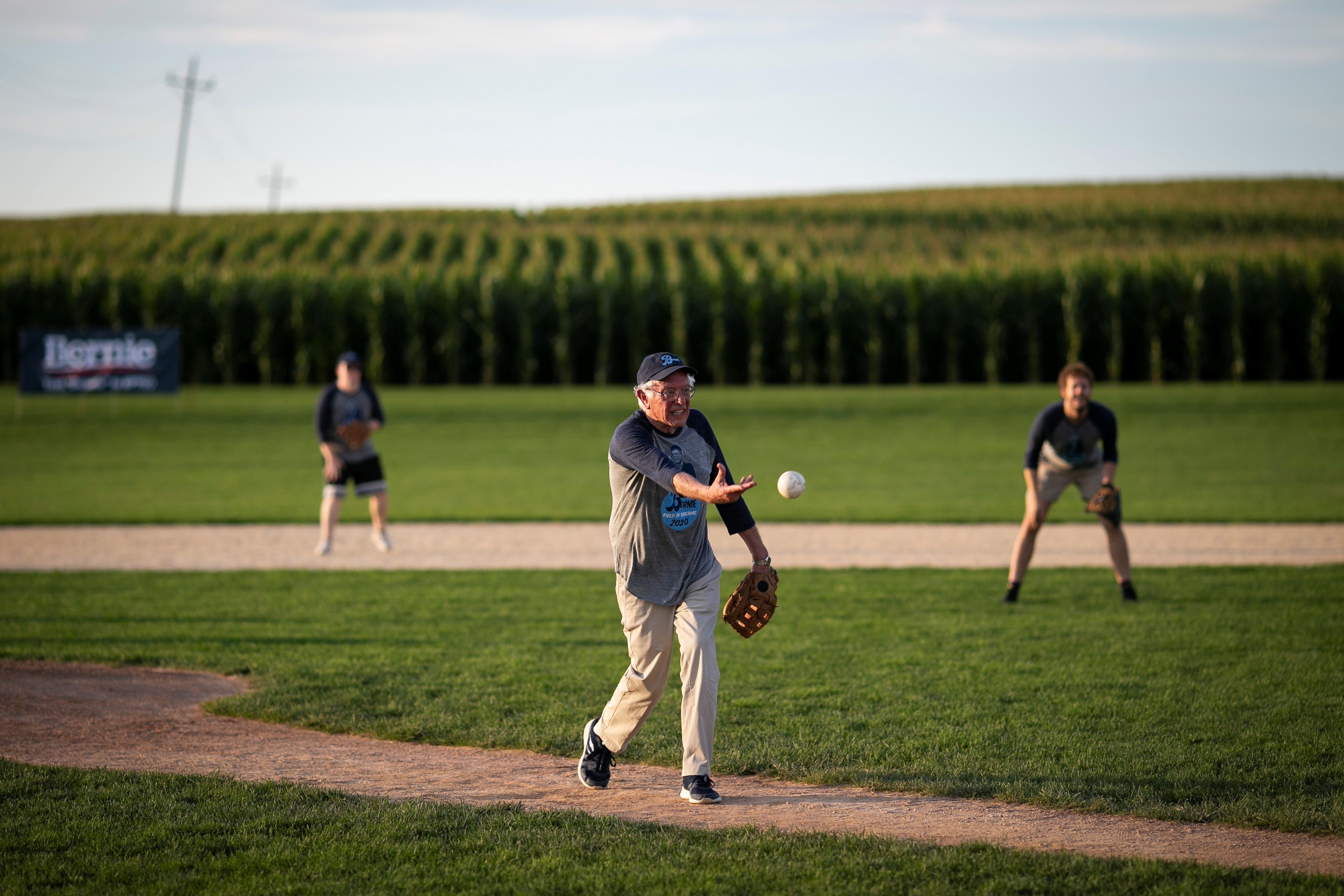 """2020 Democratic U.S. presidential candidate and U.S. Senator Bernie Sanders pitches during a baseball game between his staff, """"The Revolutionaries,"""" and the Leaders Believers Achievers Foundation. U.S., August 19, 2019. REUTERS/Al Drago"""