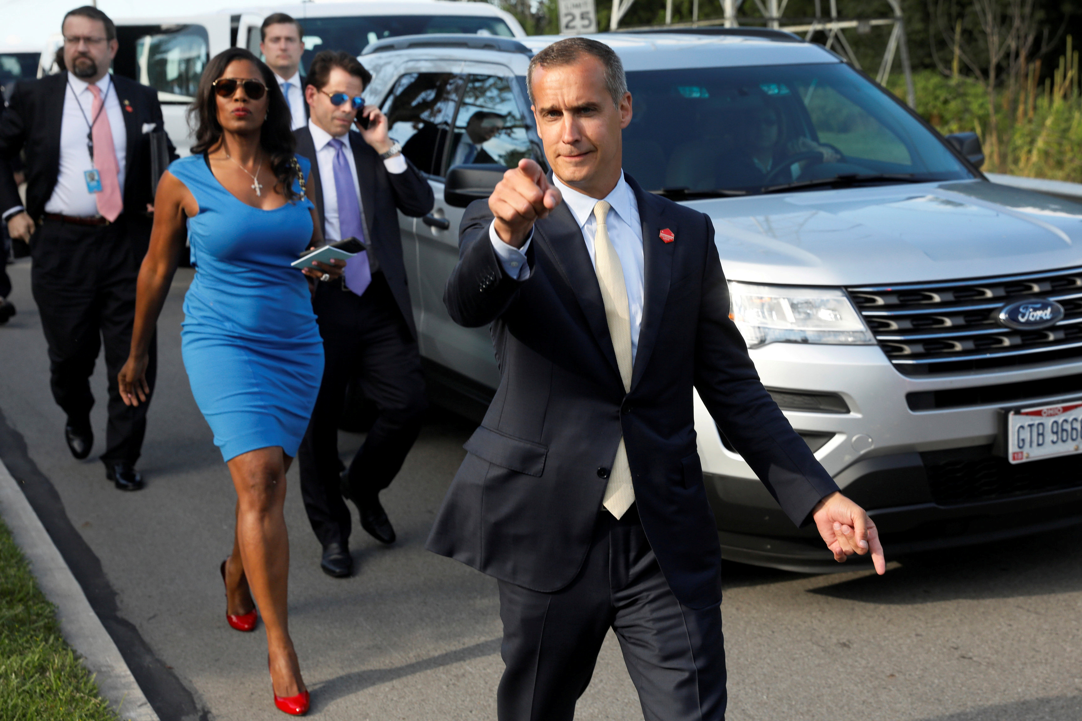 Former campaign manager Corey Lewandowski (C) says hello to reporters as he and White House advisors Sebastian Gorka (from L), Omarosa Manigault, White House Staff Secretary Rob Porter and Communications Director Anthony Scaramucci accompany President Trump for an event celebrating veterans at AMVETS Post 44 in Struthers, Ohio, U.S., July 25, 2017. Reuters/Jonathan Ernst