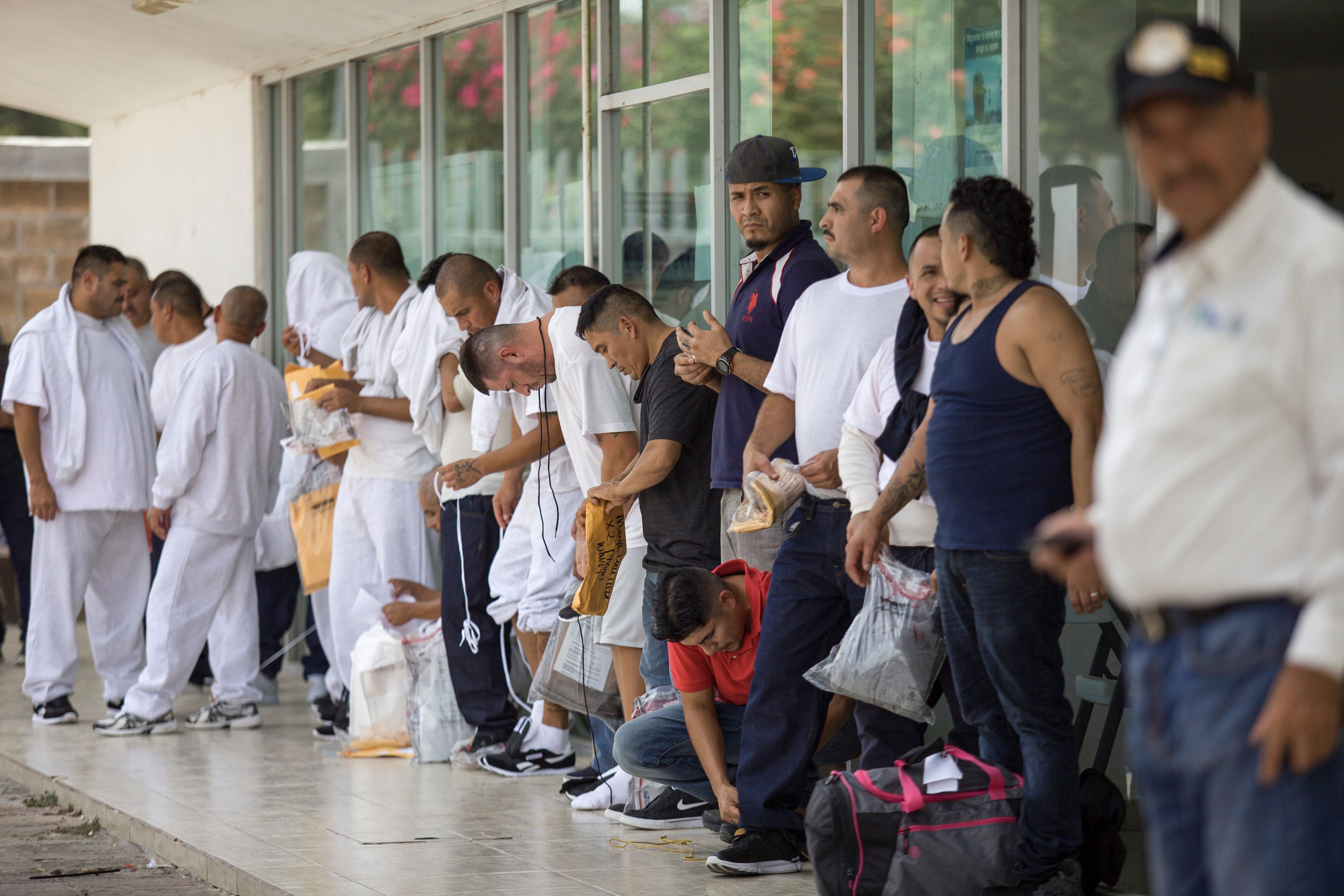 Mexican migrants wait in line after being deported by United States at the Puerta Mexico international bridge on July 22, 2019 (Carlos Ogaz/AFP/Getty Images)
