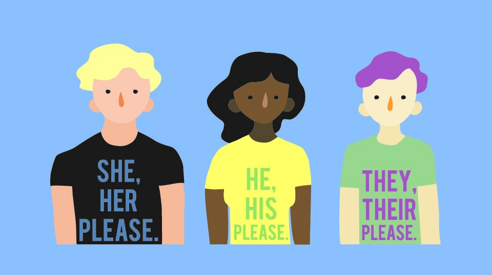 Individuals appear with their preferred pronouns emblazoned on a shirt. (Shutterstock)