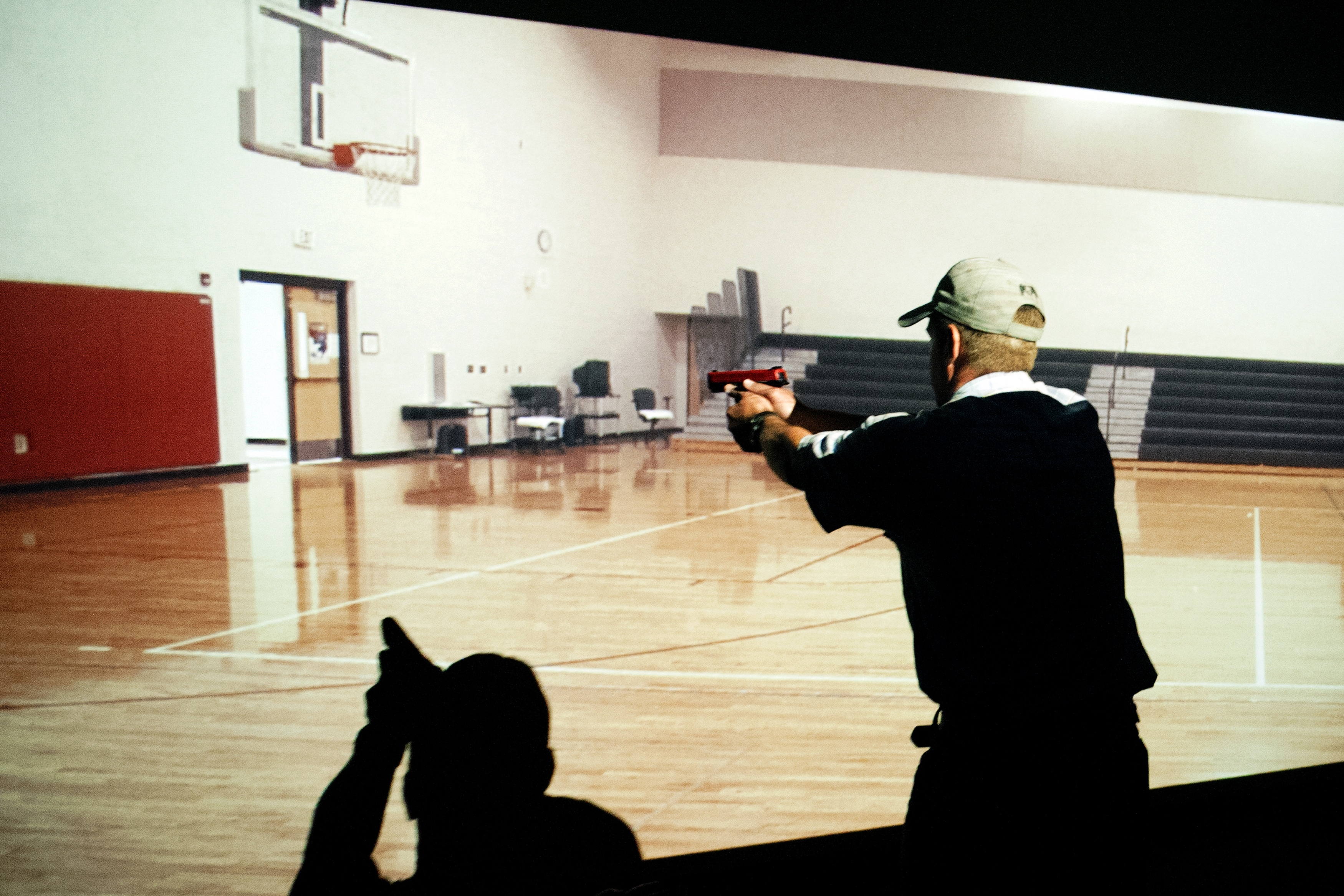 A trainee takes part in a simulated active shooter drill during a three day firearms course for school teachers and administrators sponsored by FASTER Colorado at Flatrock Training Center in Commerce City, Colorado on June 28, 2018. - FASTER Colorado has been sponsoring firearms training to Colorado teachers and administrators since 2017. Over 100 Colorado teachers and administrators have participated in the course. Colorado is one of approximately 30 states that allow firearms within school limits, and an estimated 25 school districts in Colorado allow teachers and administrators to carry concealed firearms. (Photo by JASON CONNOLLY/AFP/Getty Images)