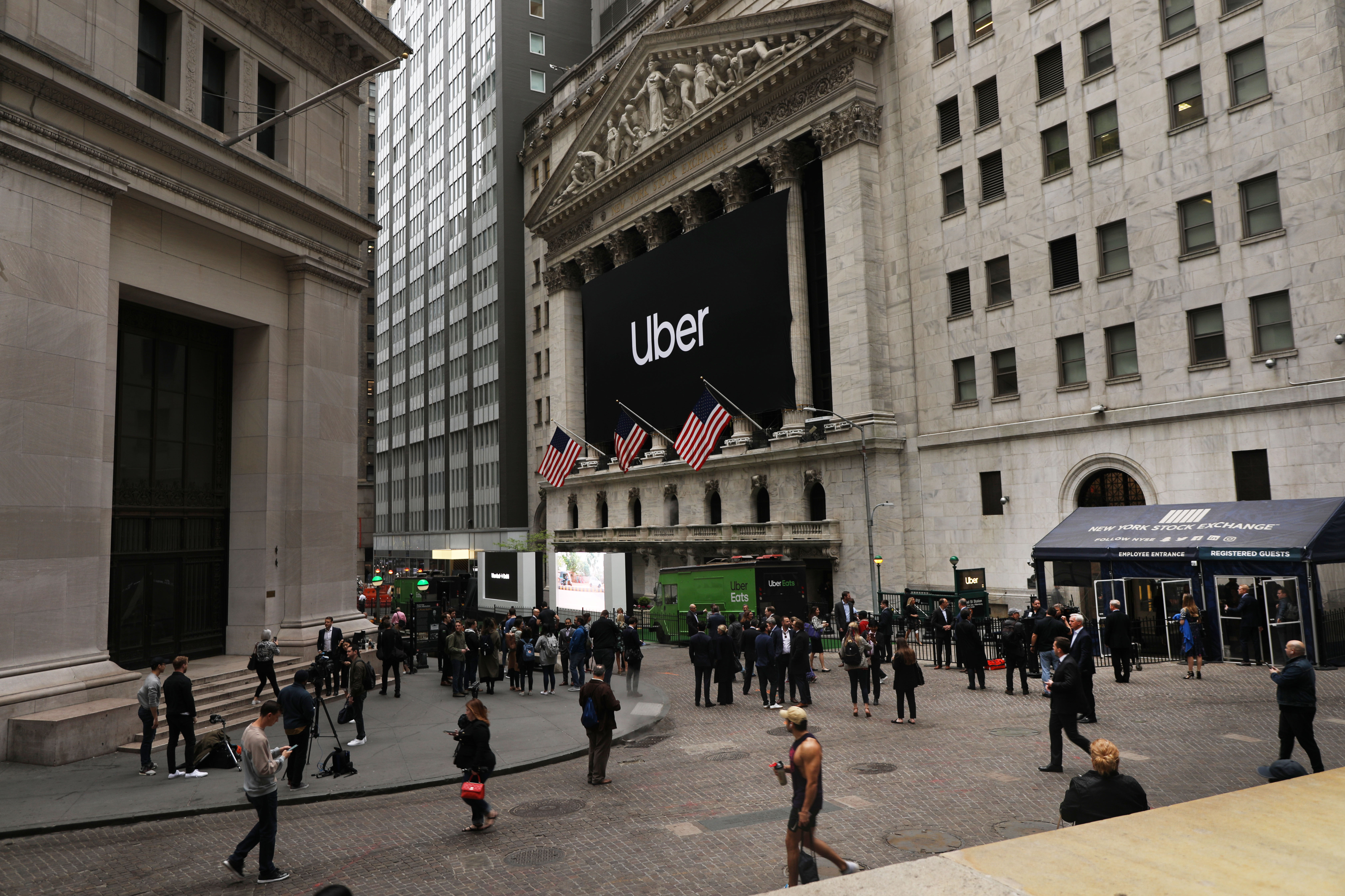 The Uber banner hangs outside of the New York Stock Exchange (NYSE) before the Opening Bell at the NYSE as the ride-hailing company Uber makes its highly anticipated initial public offering (IPO) on May 10, 2019 in New York City. (Photo by Spencer Platt/Getty Images)