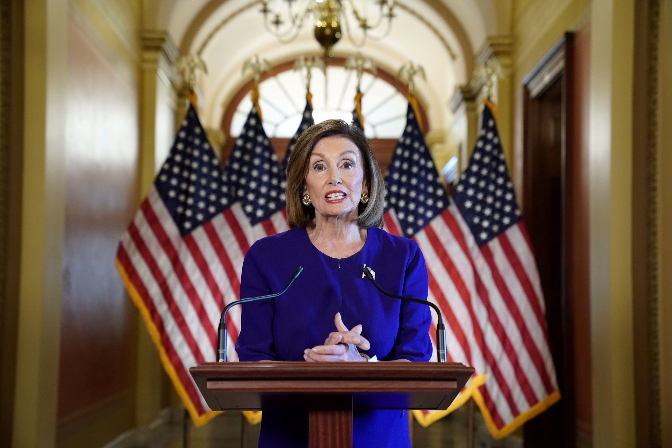 FILE PHOTO: House Speaker Nancy Pelosi (D-CA) announces the House of Representatives will launch a formal inquiry into the impeachment of U.S. President Donald Trump following a closed House Democratic caucus meeting at the U.S. Capitol in Washington, U.S., September 24, 2019. REUTERS/Kevin Lamarque/File Photo