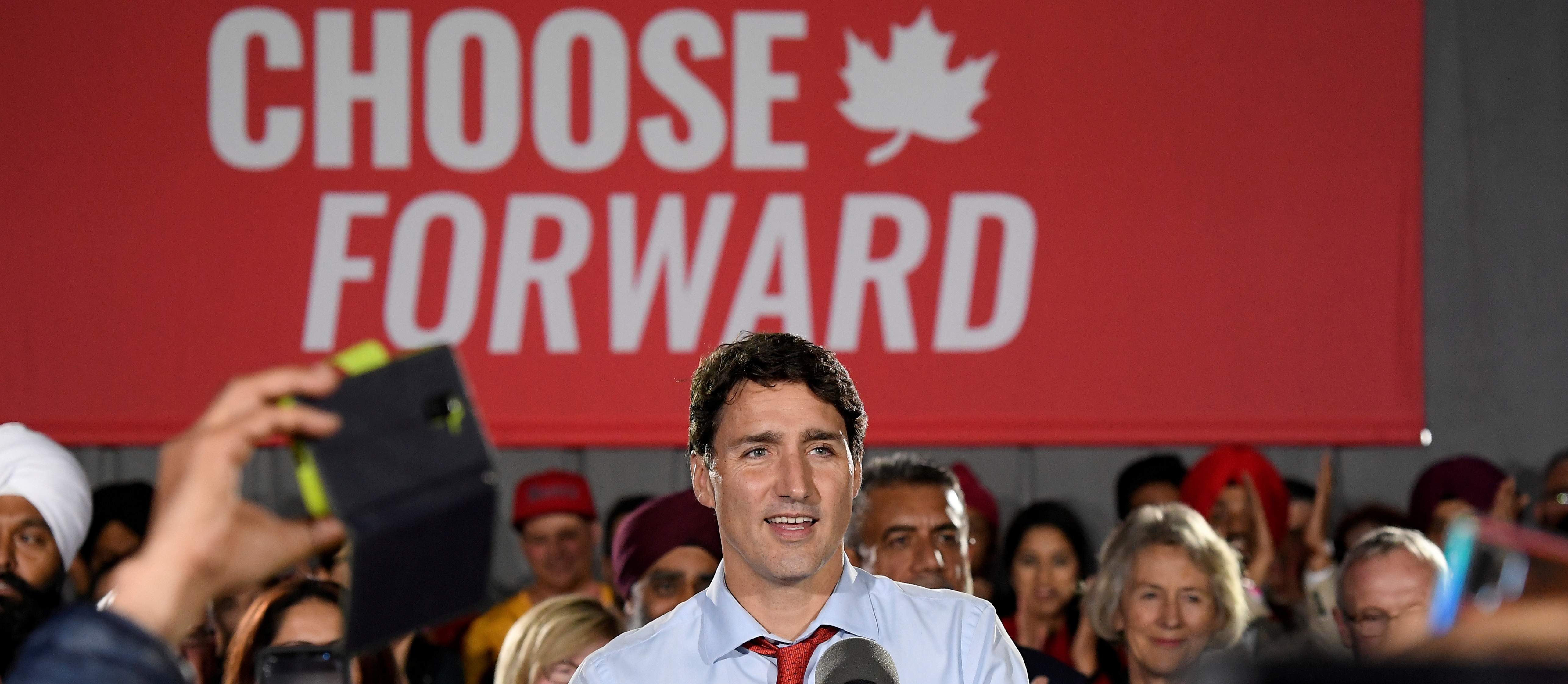 FILE PHOTO: Canada's Prime Minister Justin Trudeau speaks with supporters during an election campaign rally in Surrey, British Columbia, Canada September 24, 2019. REUTERS/Jennifer Gauthier/File Photo