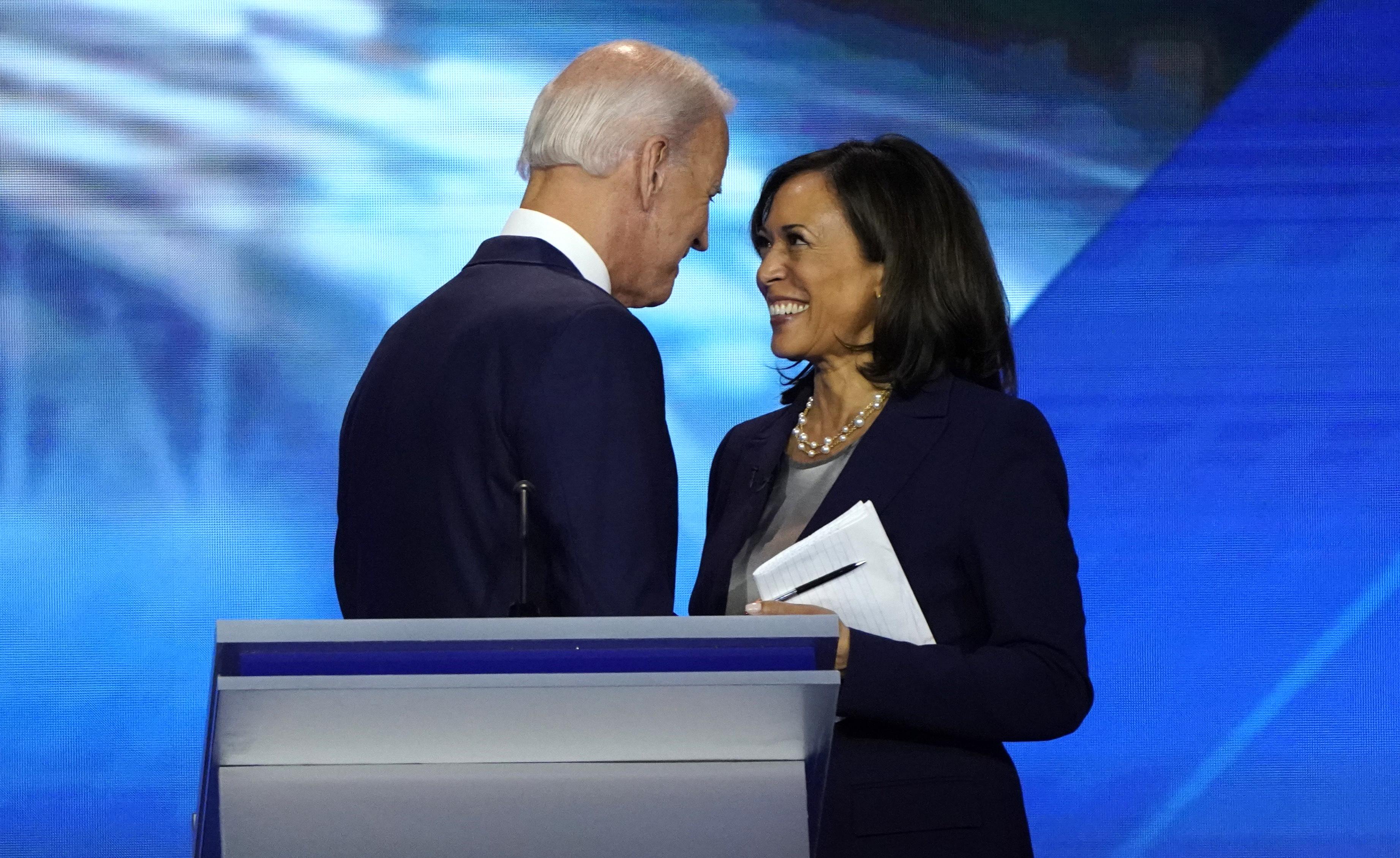 Former Vice President Joe Biden talks with Senator Kamala Harris after the conclusion of the 2020 Democratic U.S. presidential debate in Houston, Texas, U.S., September 12, 2019. REUTERS/Mike Blake