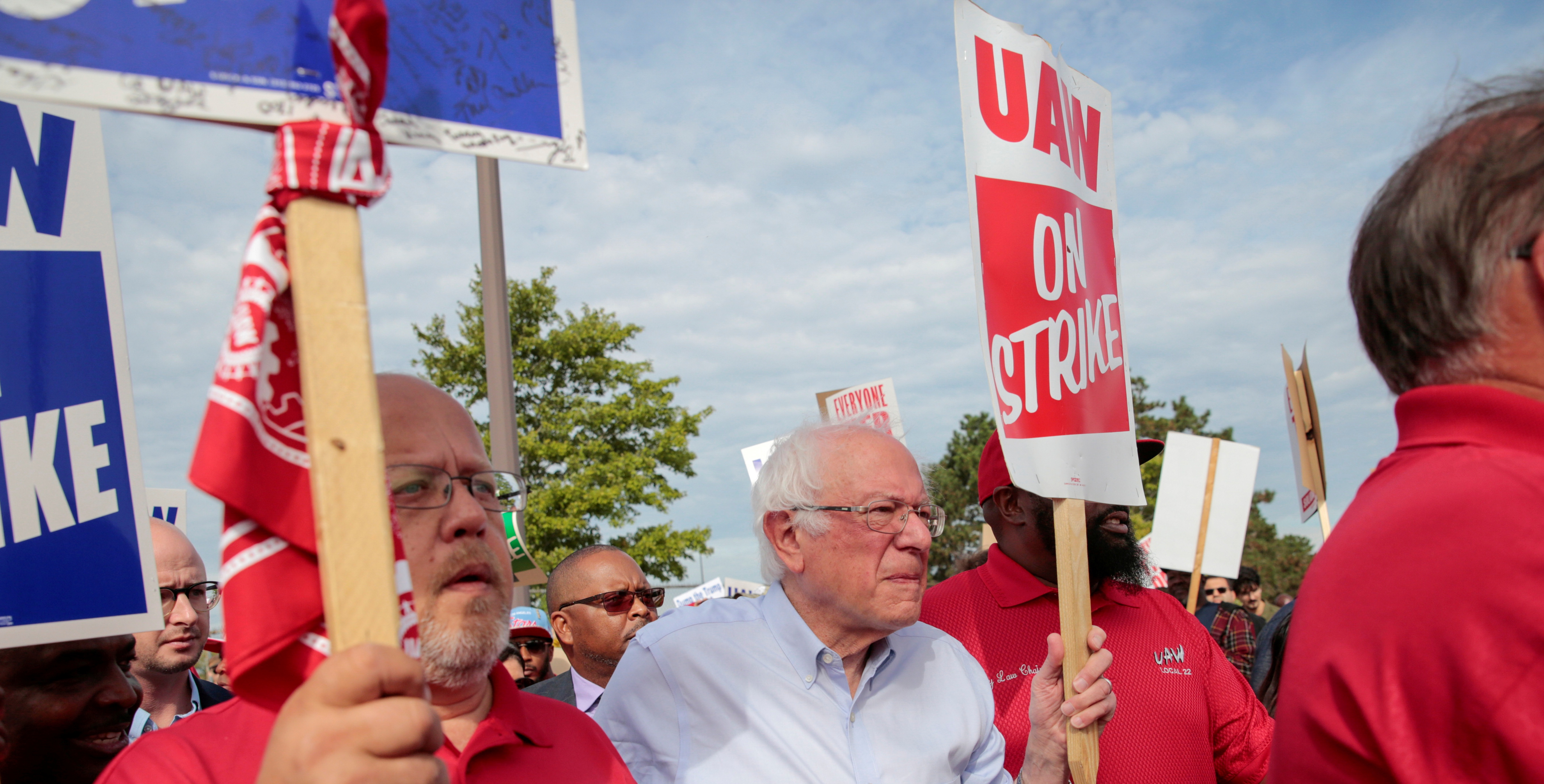 Democratic U.S. presidential candidate Senator Bernie Sanders carries a Strike sign with striking United Auto Workers (UAW) in Hamtramck, Michigan, U.S. September 25, 2019. REUTERS/Rebecca Cook