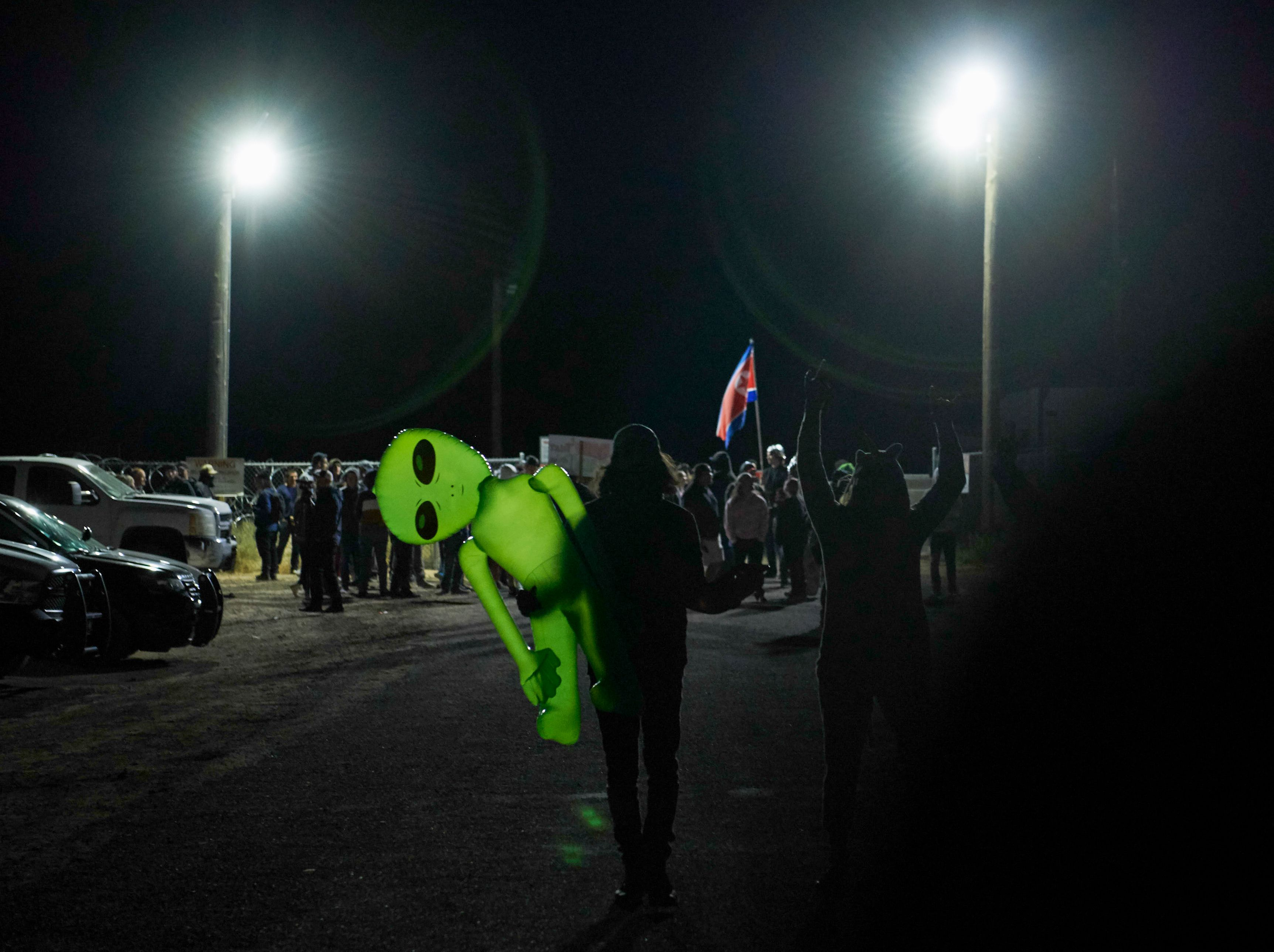 "Attendees depart after gathering to ""storm"" Area 51 at an entrance to the military facility near Rachel, Nevada on September 20, 2019. (Photo by Bridget BENNETT / AFP) (BRIDGET BENNETT/AFP/Getty Images)"