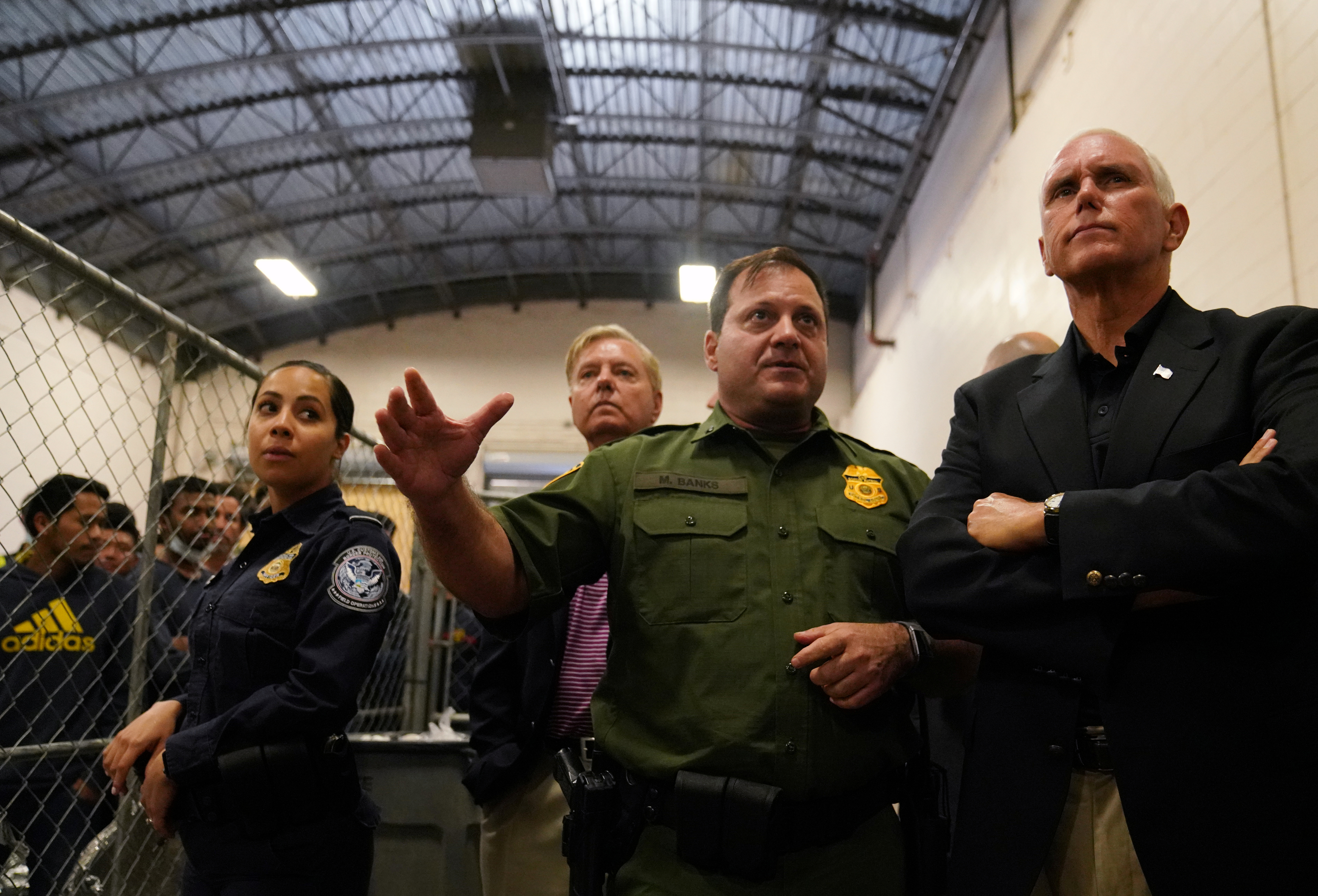 U.S. Vice President Mike Pence speaks with officers at a Border Patrol station in McAllen