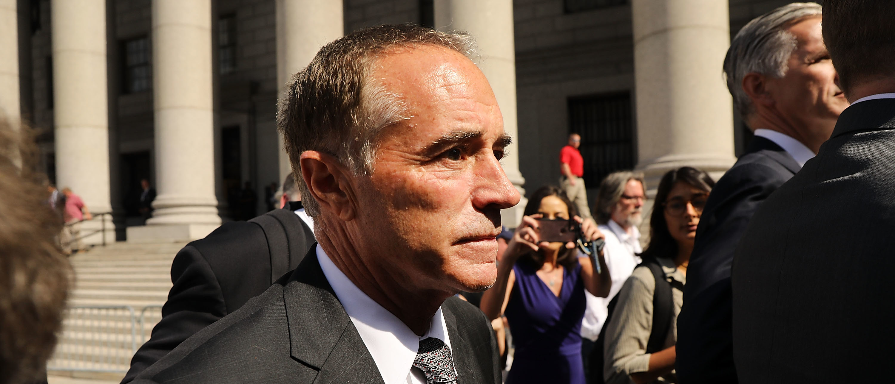 NEW YORK, NY - AUGUST 08: Rep. Chris Collins (R-NY) walks out of a New York court house after being charged with insider trading on August 8, 2018 in New York City. Federal prosecutors have charged Collins, one of President Trump's earliest congressional supporters, with securities fraud, accusing the congressman and his son of using inside information about a biotechnology company to make illicit stock trades. (Photo by Spencer Platt/Getty Images)