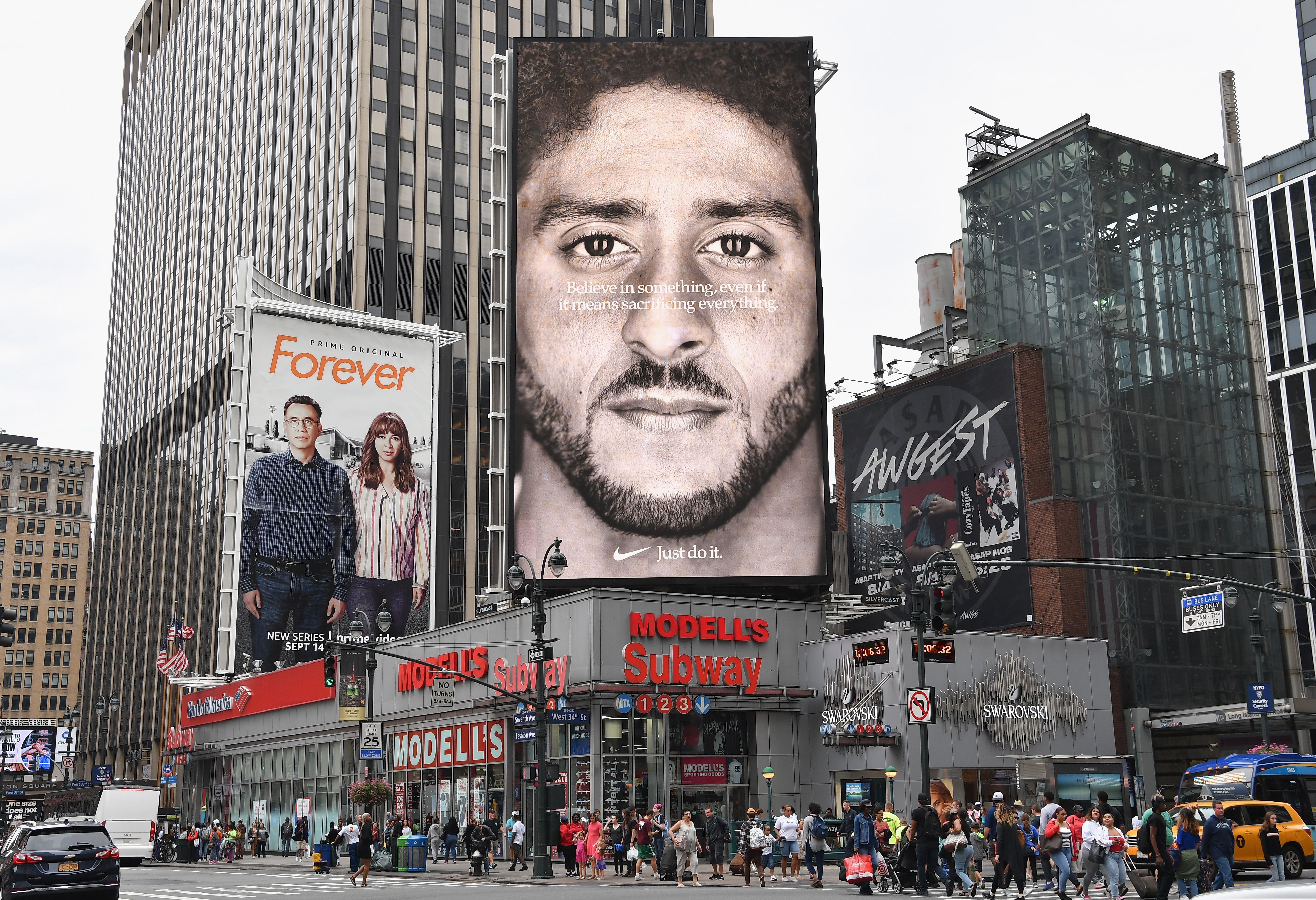 A Nike Ad featuring American football quarterback Colin Kaepernick is on diplay September 8, 2018 in New York City. - Nike's new ad campaign featuring Kaepernick, the American football player turned activist against police violence, takes a strong stance on a divisive issue which could score points with millennials but risks alienating conservative customers. The ads prompted immediate calls for Nike boycotts over Kaepernick, who has been castigated by US President Donald Trump and other conservatives over his kneeling protests during the playing of the US national anthem. (Photo credit ANGELA WEISS/AFP/Getty Images)
