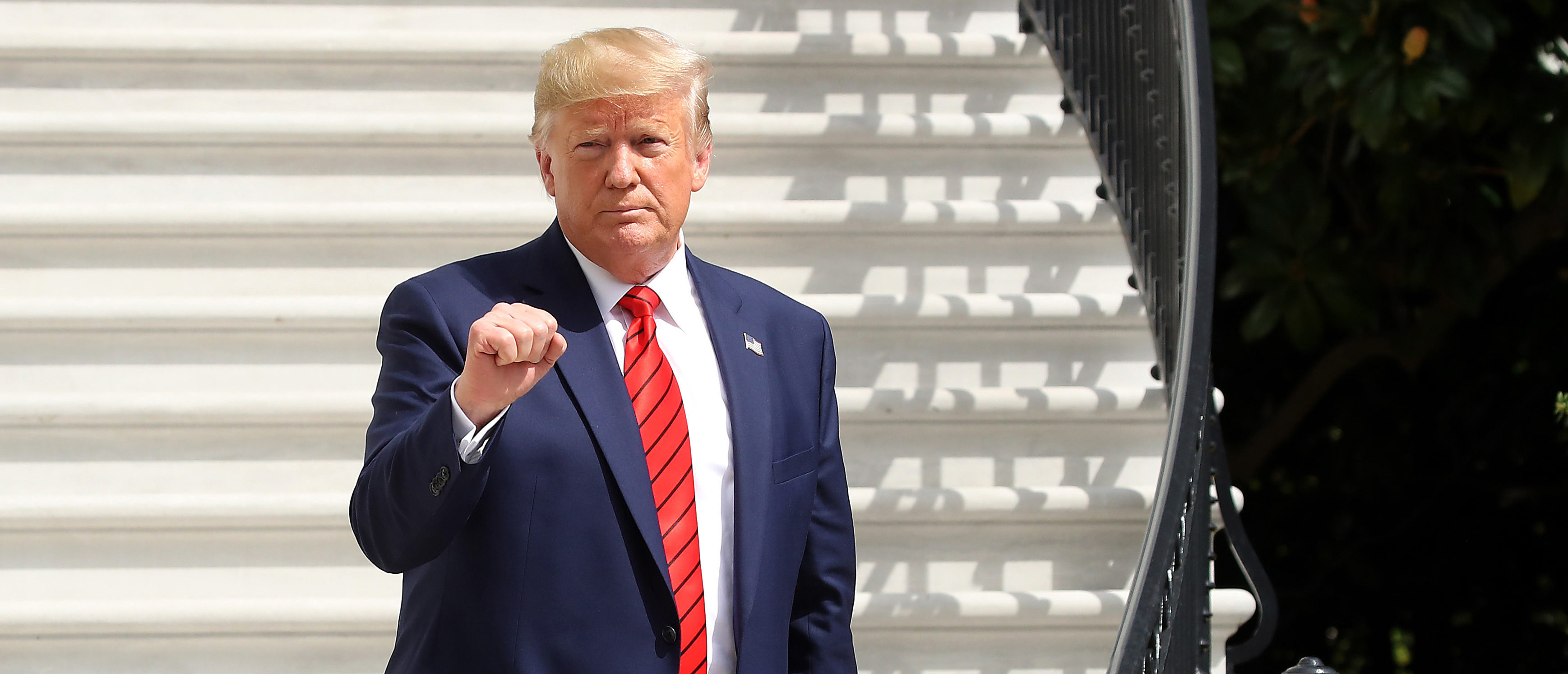 U.S. President Donald Trump gestures as he returns to the White House after attending the United Nations General Assembly on Sept. 26, 2019 in Washington, D.C. (Photo by Mark Wilson/Getty Images)