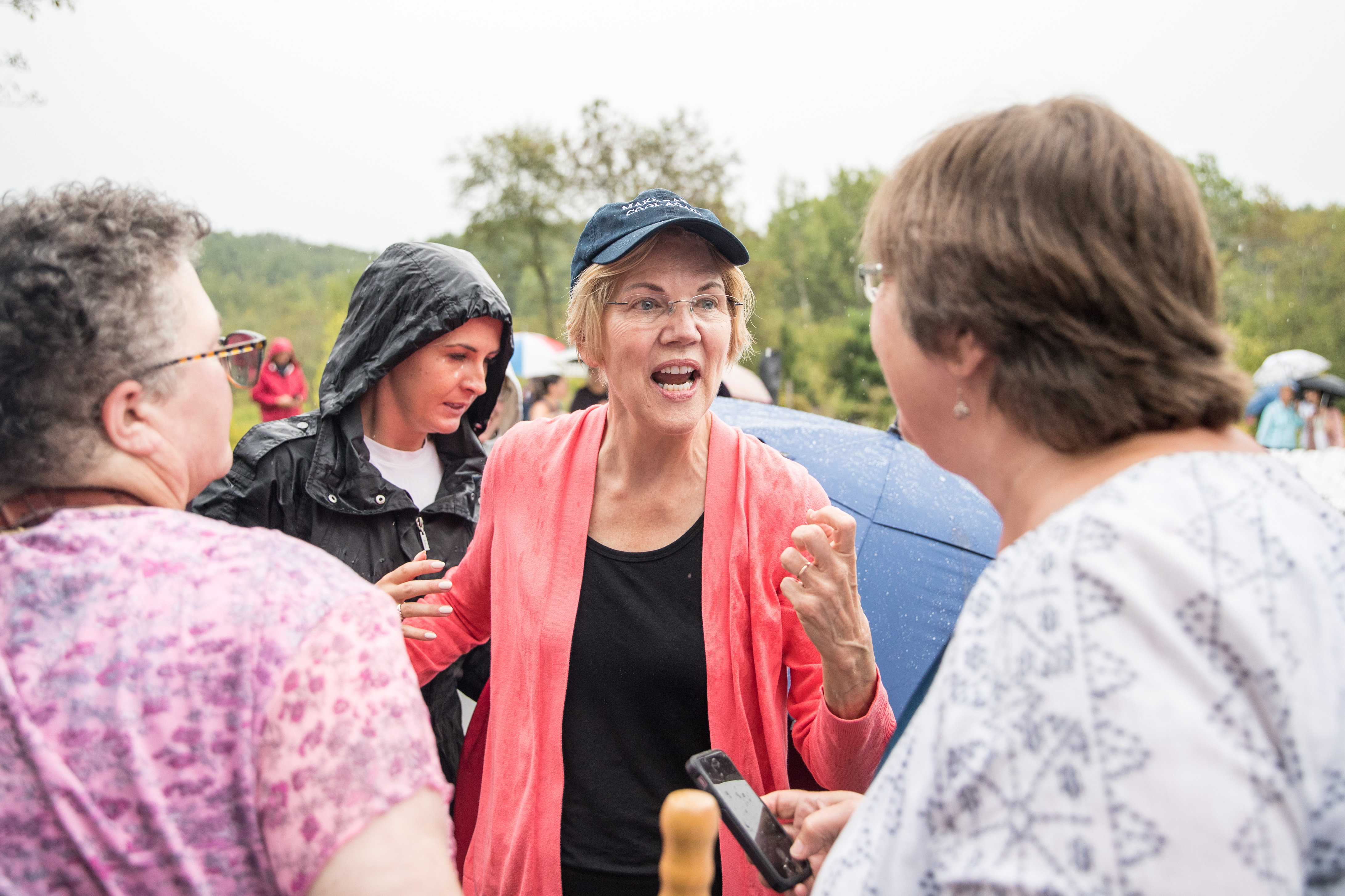 HAMPTON FALLS, NH - SEPTEMBER 02: Senator and Democratic presidential candidate Elizabeth Warren greets attendees in the rain after speaking at a Labor Day house party on September 2, 2019 in Hampton Falls, New Hampshire. (Scott Eisen/Getty Images)