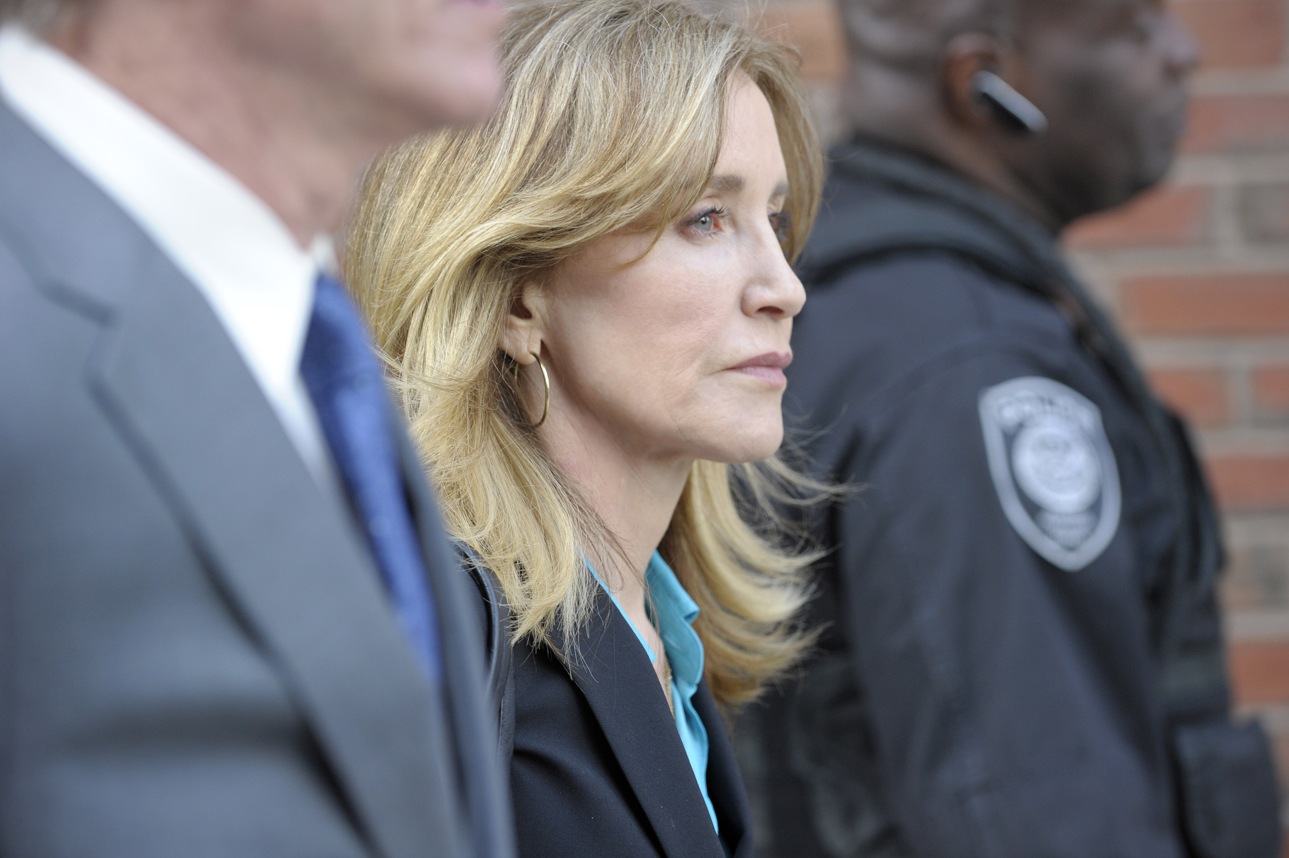 Actress Felicity Huffman exits the courthouse after facing charges for allegedly conspiring to commit mail fraud and other charges in the college admissions scandal at the John Joseph Moakley United States Courthouse in Boston on April 3, 2019. (Photo credit JOSEPH PREZIOSO/AFP/Getty Images)