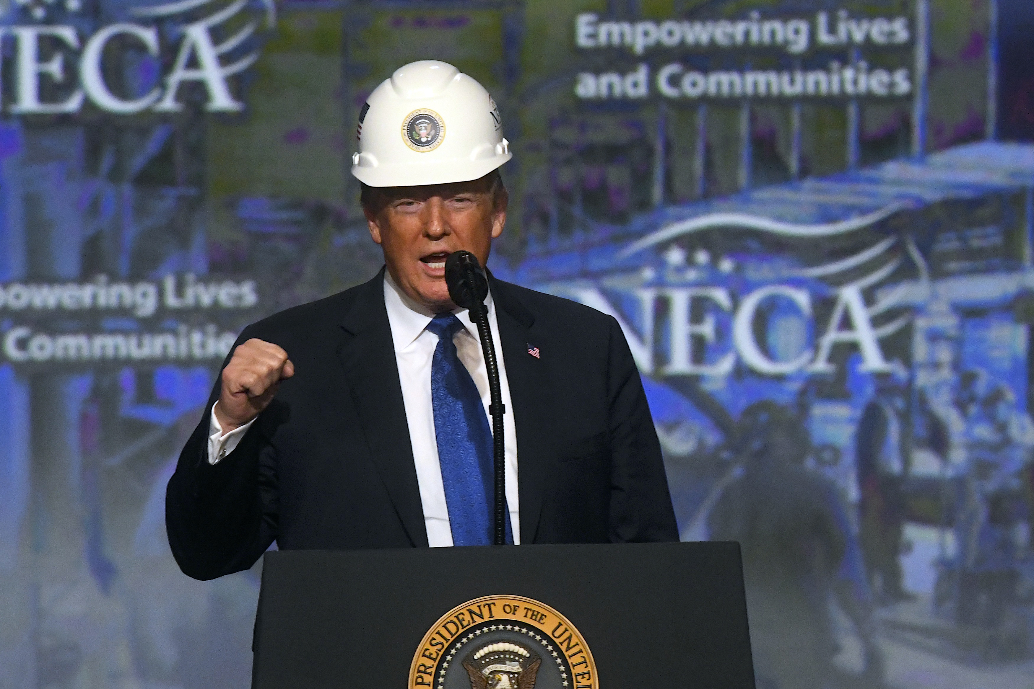 PHILADELPHIA, PA - OCTOBER 2: U.S. President Donald Trump wears a hard hat as he addresses the National Electrical Contractors Convention on October 2, 2018 in Philadelphia, Pennsylvania. The National Electrical Contractors Convention is the largest gathering of manufacturers and distributors for electrical professionals in North America. (Photo by Mark Makela/Getty Images)