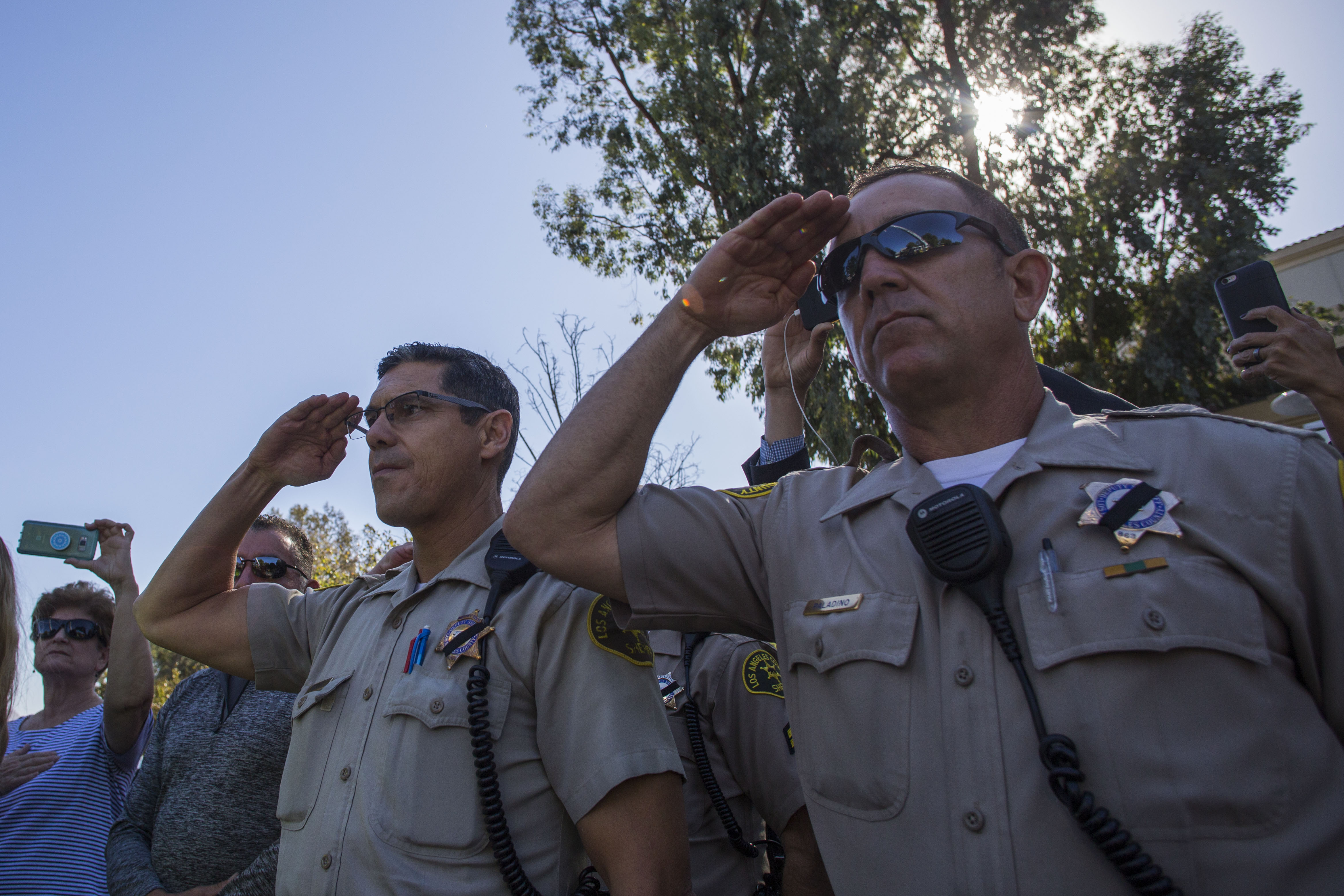 Police stand at attention as a motorcade carrying Ventura Country sheriff Sgt. Ron Helus, who was killed in a shooting at Borderline Bar the night before, passes by outside the Los Robles Medical Center in Thousands Oaks, California on November 8, 2018. - The gunman who killed 12 people in a crowded California country music bar has been identified as 28-year-old Ian David Long, a former Marine, the local sheriff said Thursday. The suspect, who was armed with a .45-caliber handgun, was found deceased at the Borderline Bar and Grill, the scene of the shooting in the city of Thousand Oaks northwest of downtown Los Angeles. (APU GOMES/AFP/Getty Images)