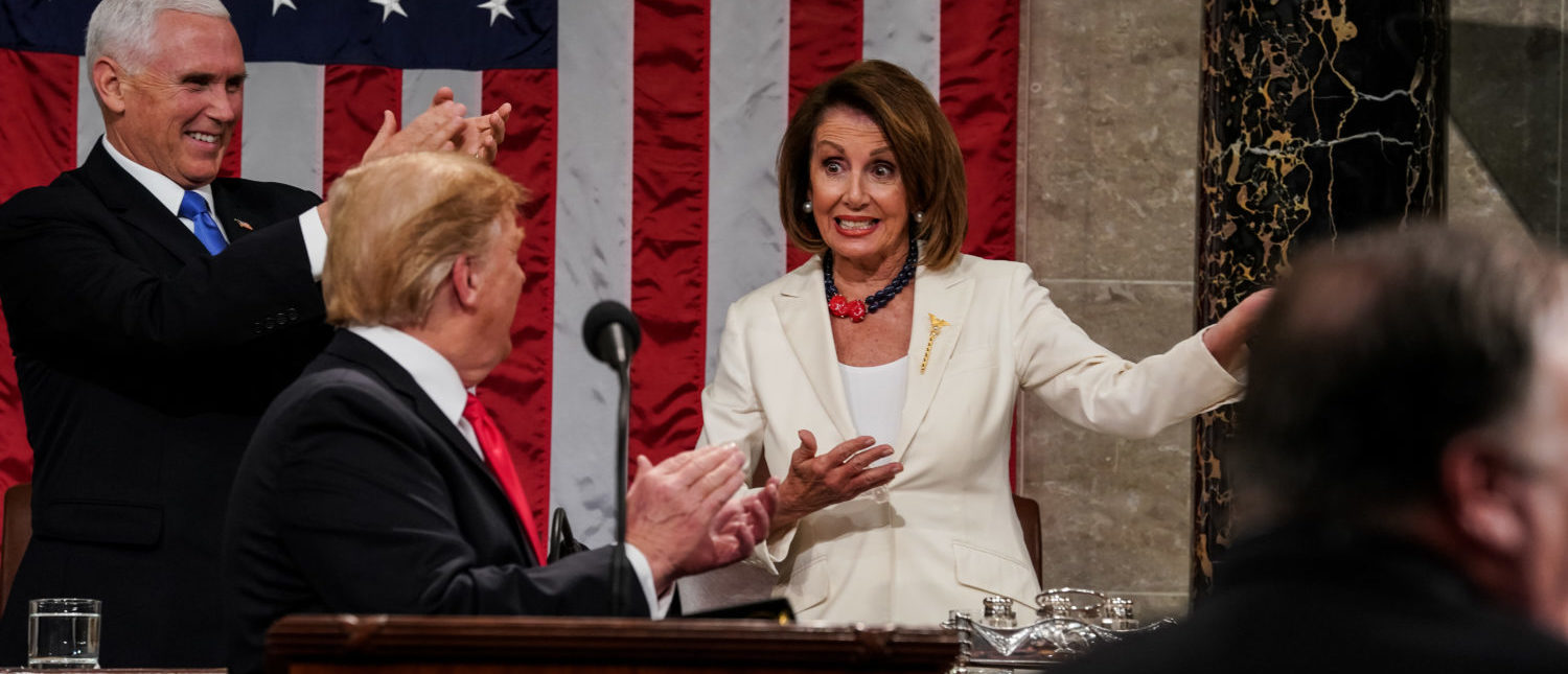 WASHINGTON, DC - FEBRUARY 5: Speaker Nancy Pelosi gestures as President Donald Trump and Vice President Mike Pence applaud during the State of the Union address in the chamber of the U.S. House of Representatives at the U.S. Capitol Building on February 5, 2019 in Washington, DC. President Trump's second State of the Union address was postponed one week due to the partial government shutdown. (Photo by Doug Mills-Pool/Getty Images)