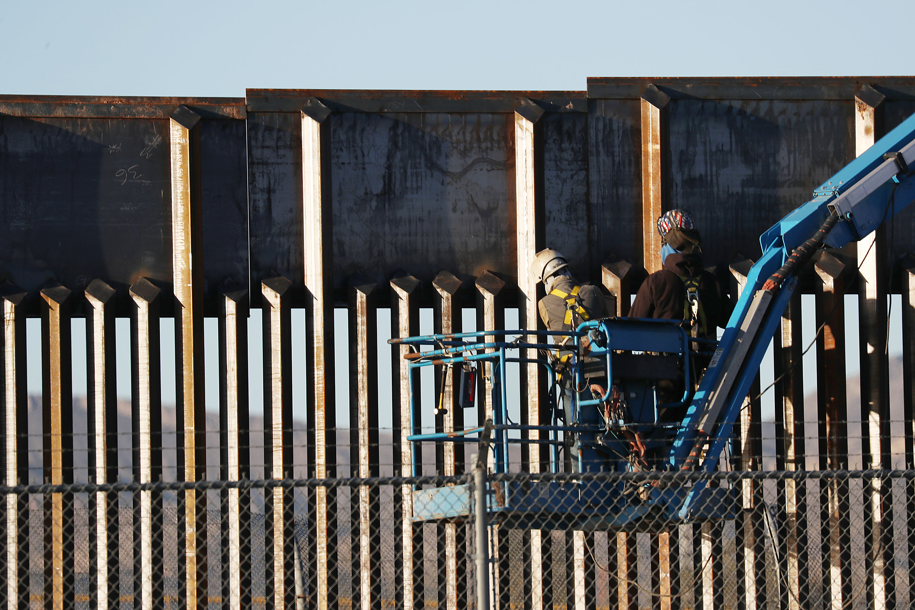 EL PASO, TEXAS - FEBRUARY 12: People work on the U.S./ Mexican border wall on February 12, 2019 in El Paso, Texas. U.S. President Donald Trump visited the border city yesterday as he continues to campaign for more wall to be built along the border. Democrats in Congress are asking for other additional border security measures. (Photo by Joe Raedle/Getty Images)