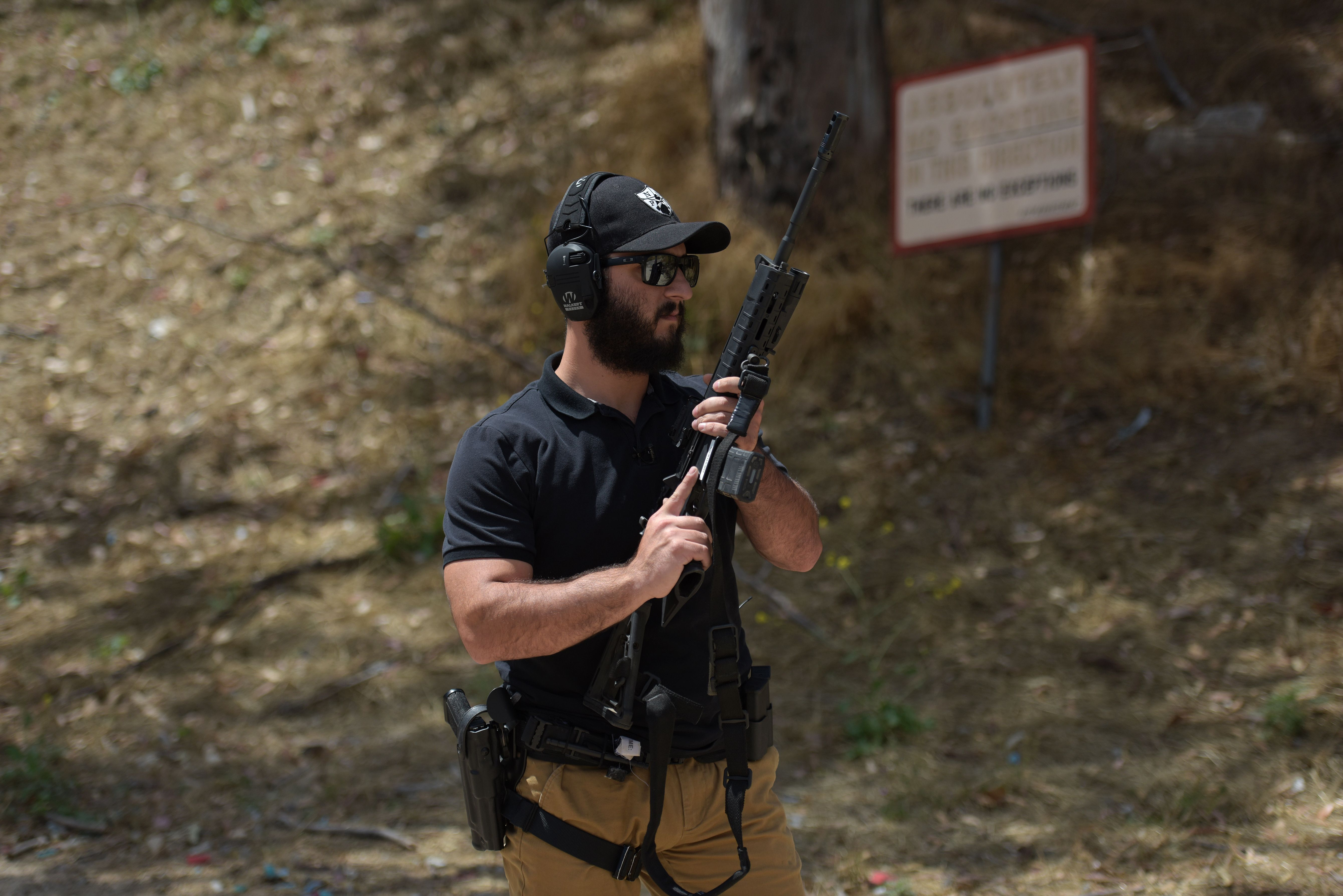 "Rabbi Raziel Cohen, aka ""Tactical Rabbi"", holds an AR-15 style semi-automatic rifle during a demonstration at the Angeles Shooting Ranges in Pacoima, California on May 20, 2019. (AGUSTIN PAULLIER/AFP/Getty Images)"