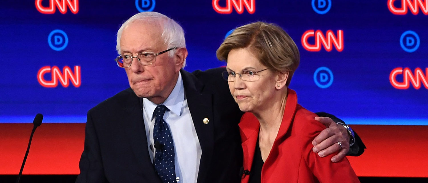 (FILES) In this file photo taken on July 30, 2019 Democratic presidential hopefuls US Senator from Vermont Bernie Sanders (L) and US Senator from Massachusetts Elizabeth Warren hug after participating in the first round of the second Democratic primary debate of the 2020 presidential campaign season in Detroit, Michigan. - The huge field of Democratic presidential aspirants has finally begun to shrink: recently, four candidates for the White House have thrown in the sponge. But 21 others are still in the running. And in this crowded arena, former vice president Joe Biden is clinging to his lead despite an often rocky summer and the steady rise of progressive senator Elizabeth Warren. Once the list of participants qualifying for the Democrats' third round of debates is confirmed next week, other presidential hopefuls are expected to drop out in quick succession. (Photo by Brendan Smialowski / AFP) (Photo credit should read BRENDAN SMIALOWSKI/AFP/Getty Images)