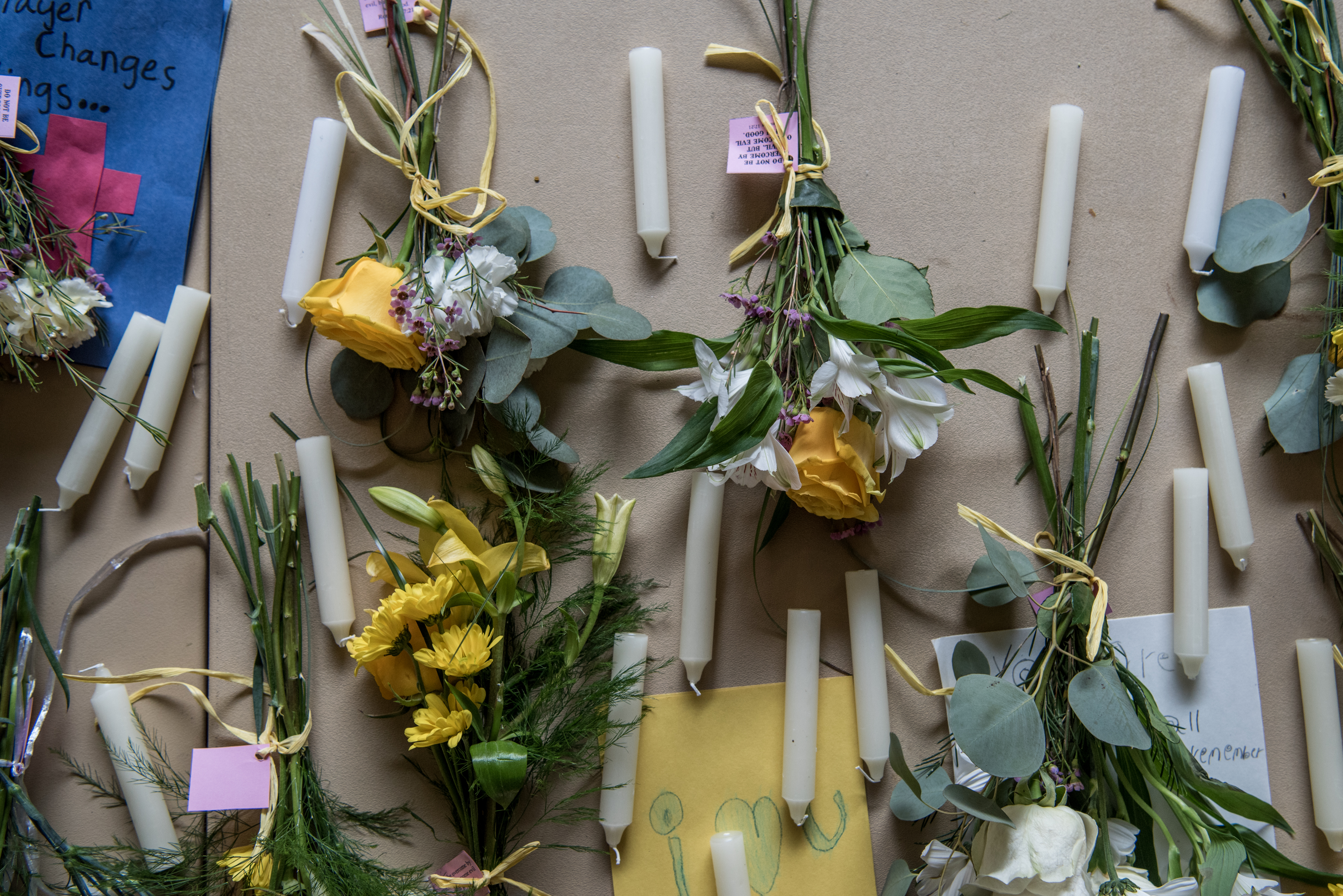 Small flower bouquets and candles provided by local Odessa residents are seen before a prayer vigil at the University of Texas of the Permian Basin (UTPB) for the victims of a mass shooting, September 1, 2019 in Odessa, Texas. (Photo by Cengiz Yar/Getty Images)