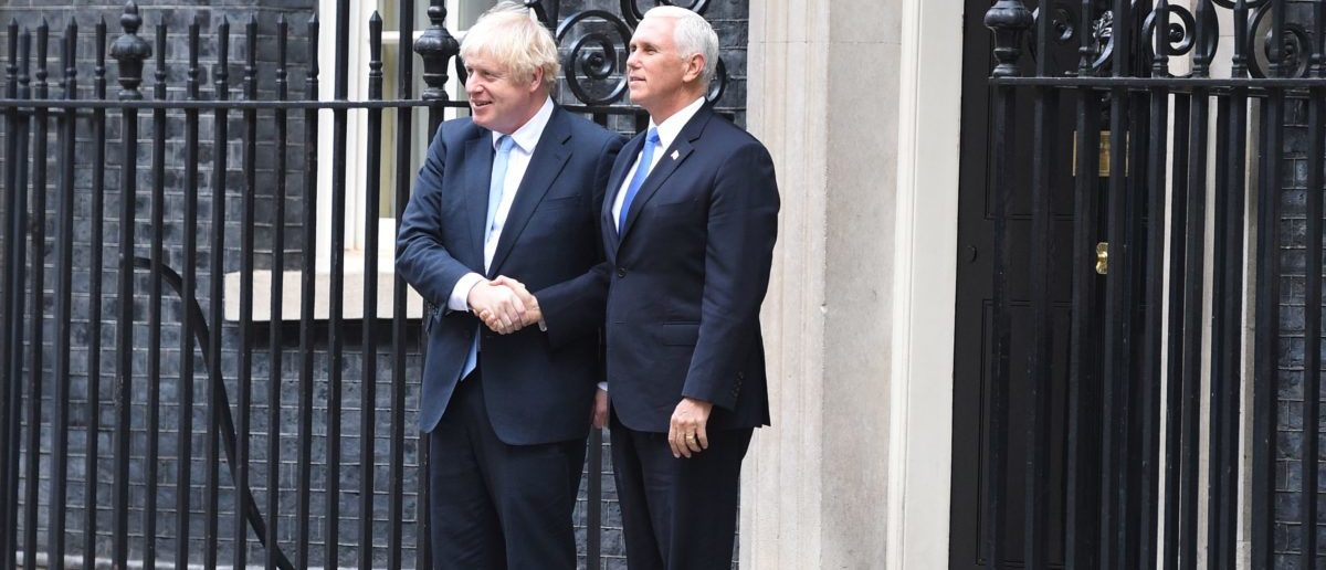 Britain's Prime Minister Boris Johnson (L) greets US Vice-President Mike Pence in central London on September 5, 2019. (OLI SCARFF/AFP/Getty Images)