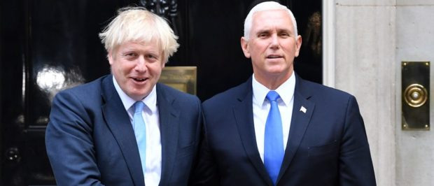 Britain's Prime Minister Boris Johnson greets US Vice-President Mike Pence in central London (DANIEL LEAL-OLIVAS/AFP/Getty Images)