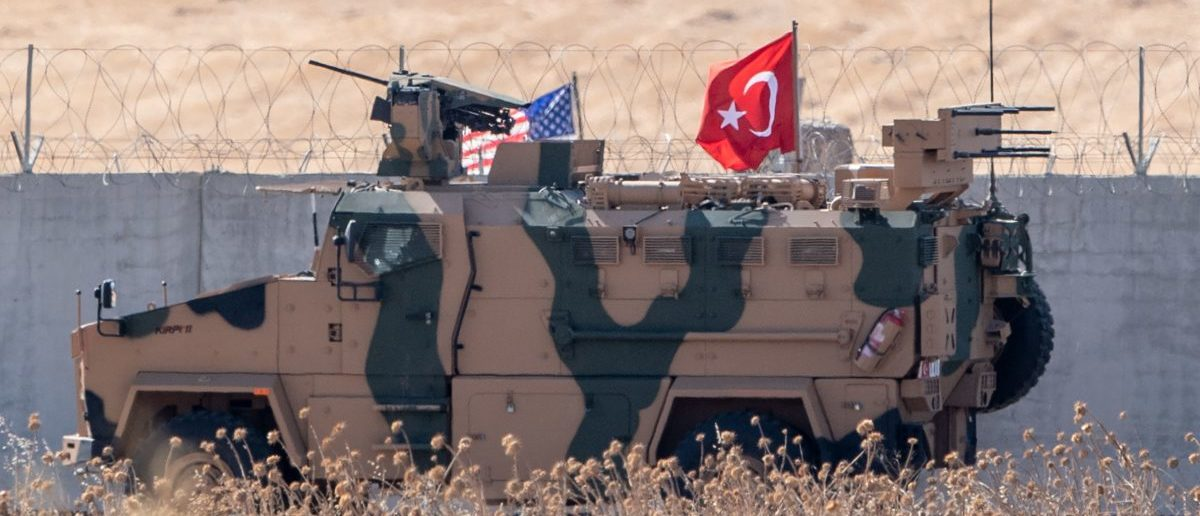This picture taken on September 8, 2019 shows US and Turkish (R) armoured vehicles taking part in their first joint patrol with Turkey under a deal reached between Washington and Ankara, at the border with Syria near Akcakale, in the Sanliurfa province of Turkey. (BULENT KILIC/AFP/Getty Images)