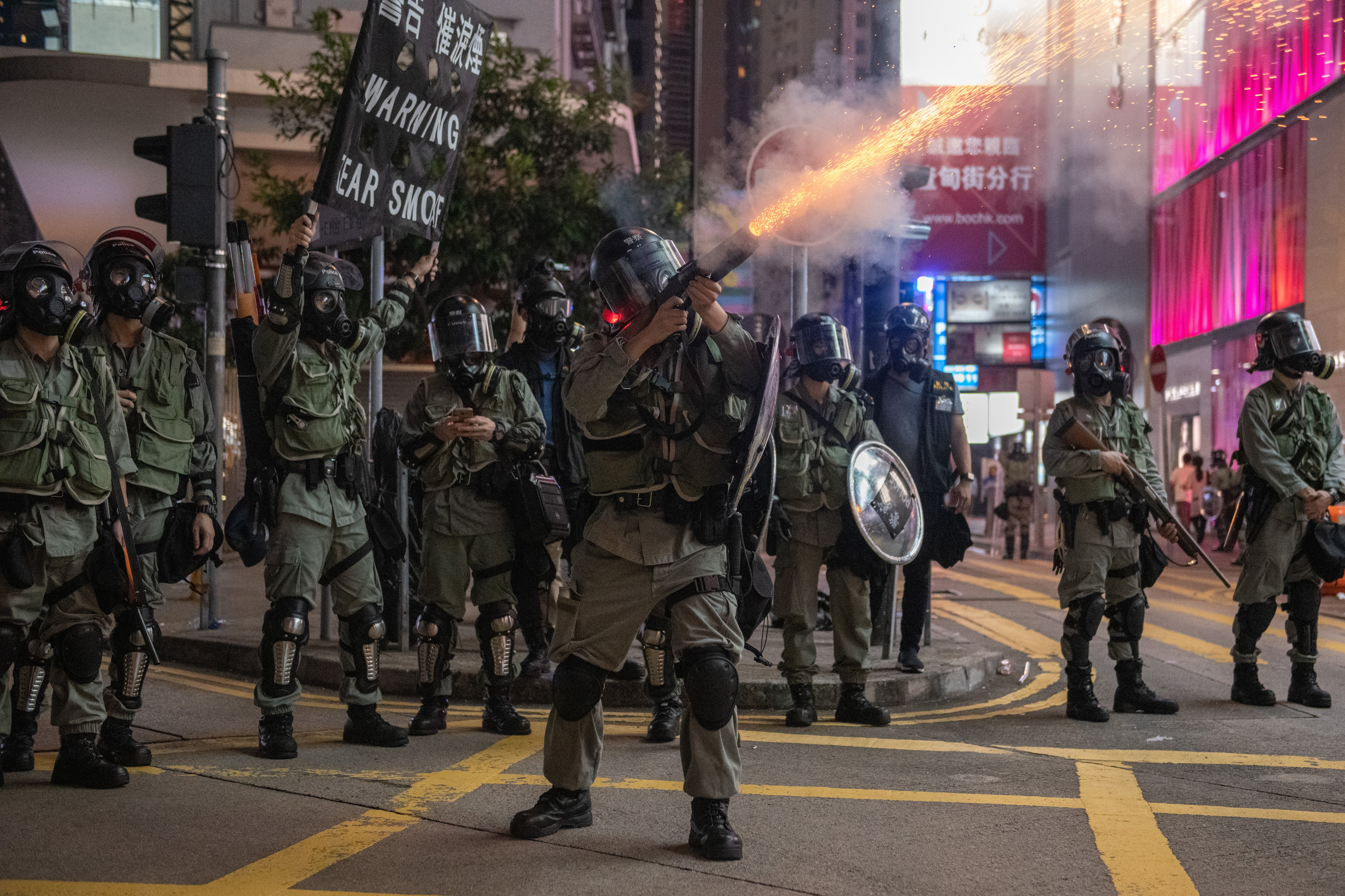 A police officer fires teargas at protesters on September 8, 2019 in Hong Kong, China. Pro-democracy protesters have continued demonstrations across Hong Kong despite the withdrawal of a controversial extradition bill as demonstrators call for the city's Chief Executive Carrie Lam to immediately meet the rest of their demands, including an independent inquiry into police brutality, the retraction of the word 'riot' to describe the rallies, and the right for Hong Kong people to vote for their own leaders. (Photo by Carl Court/Getty Images)