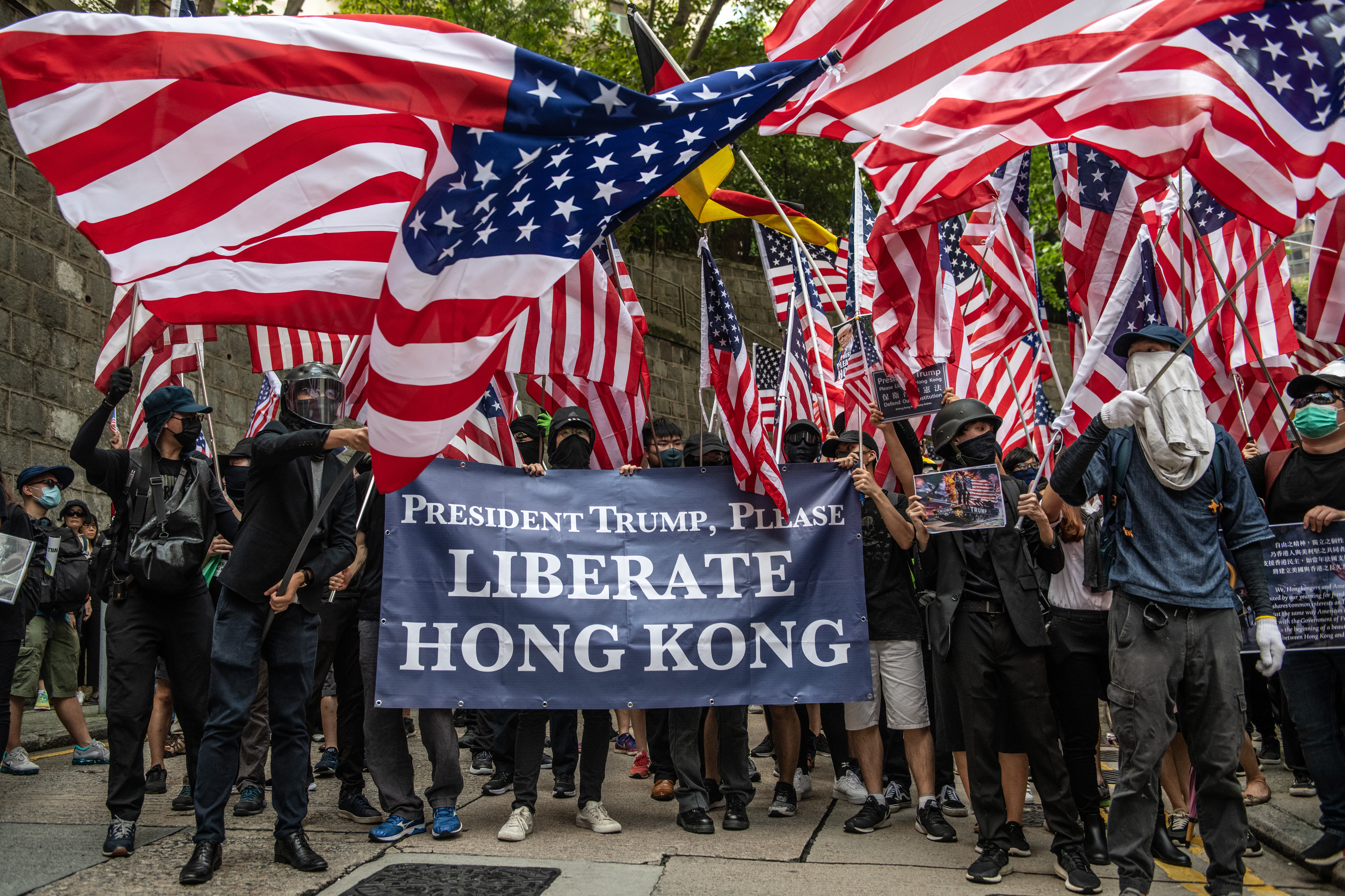Protesters wave U.S flags outside the U.S consulate after delivering a petition on September 8, 2019 in Hong Kong, China. Pro-democracy protesters have continued demonstrations across Hong Kong despite the withdrawal of a controversial extradition bill as demonstrators call for the city's Chief Executive Carrie Lam to immediately meet the rest of their demands, including an independent inquiry into police brutality, the retraction of the word 'riot' to describe the rallies, and the right for Hong Kong people to vote for their own leaders. (Photo by Carl Court/Getty Images)