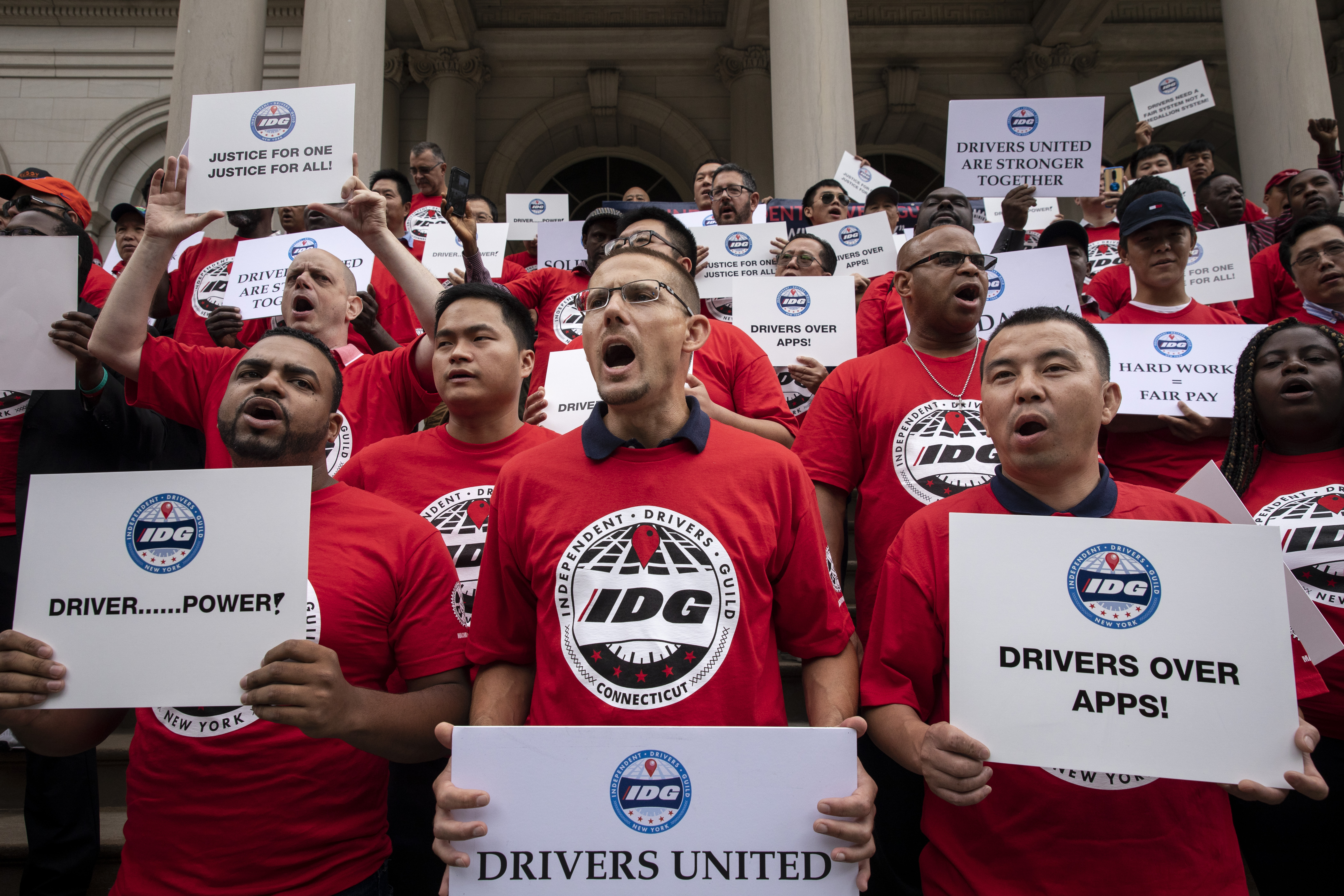Ride-share drivers and supporters with the Independent Drivers Guild protest outside New York City Hall as they rally for wage enforcement and a drivers' bill of rights, on September 10, 2019 in New York City. (Photo by Drew Angerer/Getty Images)