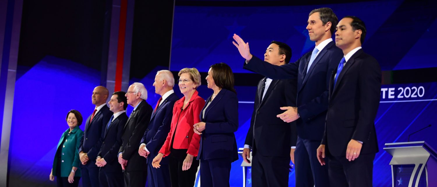 Democratic presidential hopefuls (L-R) Senator of New Jersey Cory Booker, Mayor of South Bend, Indiana, Pete Buttigieg, Senator of Vermont Bernie Sanders, Former Vice President Joe Biden, Senator of Massachusetts Elizabeth Warren, Senator of California Kamala Harris, Tech entrepreneur Andrew Yang, Former Representative of Texas Beto O'Rourke and Former housing secretary Julian Castro stand onstage ahead of the third Democratic primary debate of the 2020 presidential campaign season hosted by ABC News in partnership with Univision at Texas Southern University in Houston, Texas on September 12, 2019. (Photo by Frederic J. BROWN / AFP) (Photo credit should read FREDERIC J. BROWN/AFP/Getty Images)