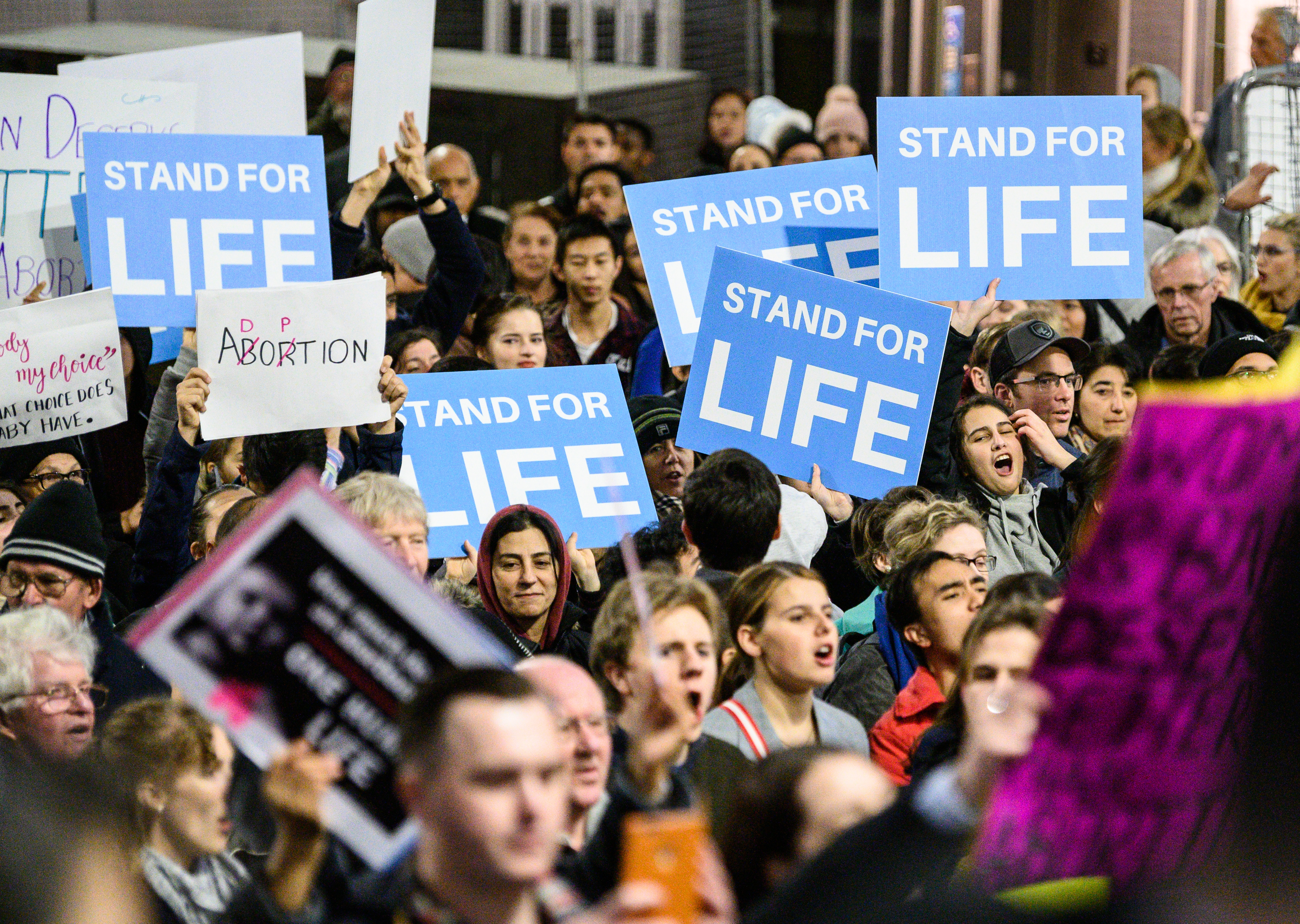 SYDNEY, AUSTRALIA - AUGUST 20: Pro-Life protestors demonstrating on August 20, 2019 in Martin Place, Sydney, Australia. The protesters oppose the NSW abortion bill which will decriminalise Abortion. The rally organisers say it will allow abortion for any reason until birth and won't prevent sex selection terminations. A vote on the bill was planned to take place this week but has been delayed until the Mid September. (Photo by James Gourley/Getty Images)
