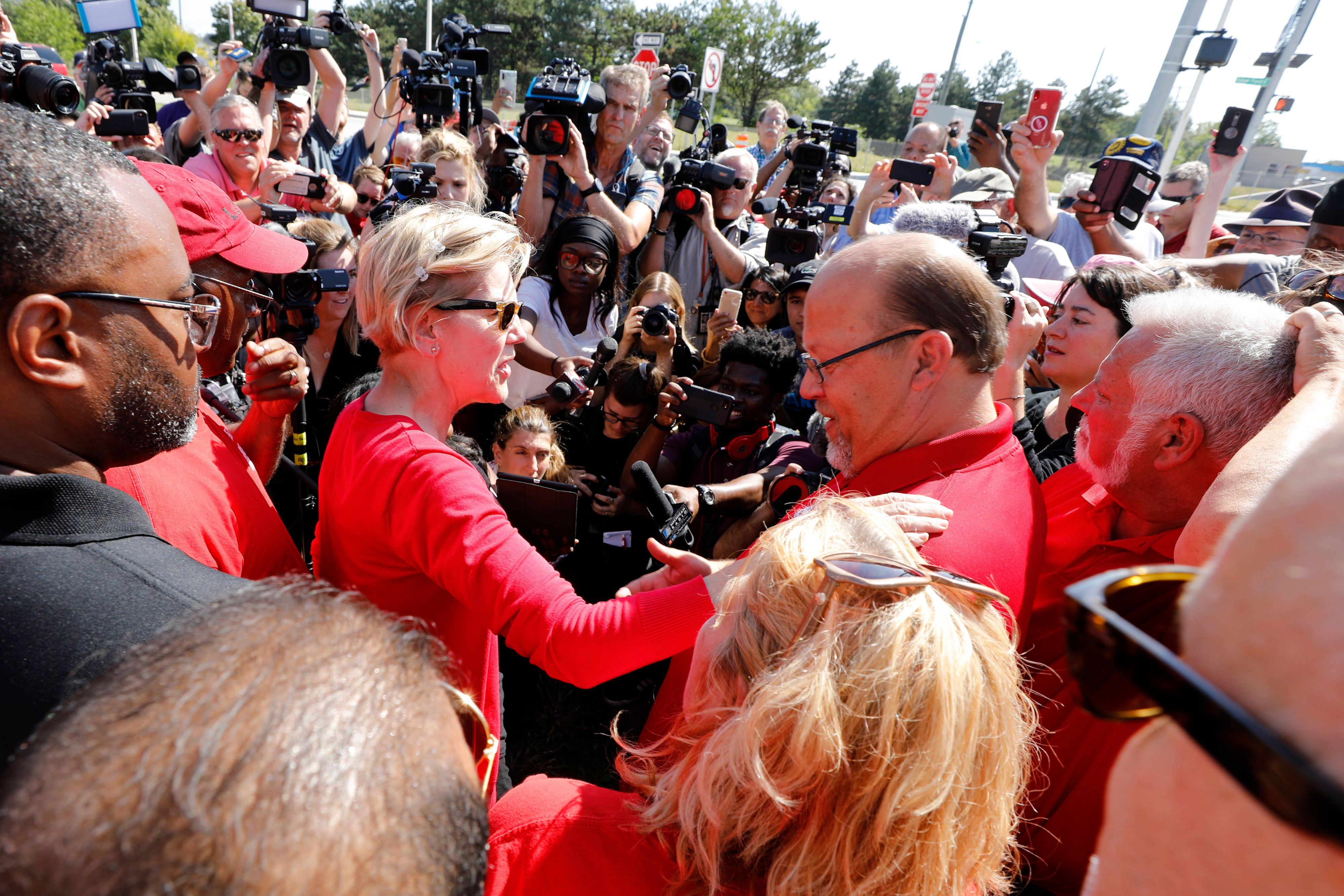 US 2020 Democratic presidential hopeful US Senator from Massachusetts Elizabeth Warren joins members of the United Auto Workers (UAW) and supporters as they picket outside of General Motors Detroit-Hamtramck Assembly in Detroit, Michigan, as they strike on September 22, 2019. - The United Auto Workers union began a nationwide strike against General Motors on September 16, with some 46,000 members walking off the job after contract talks hit an impasse. (Photo by JEFF KOWALSKY / AFP) (Photo credit should read JEFF KOWALSKY/AFP/Getty Images)