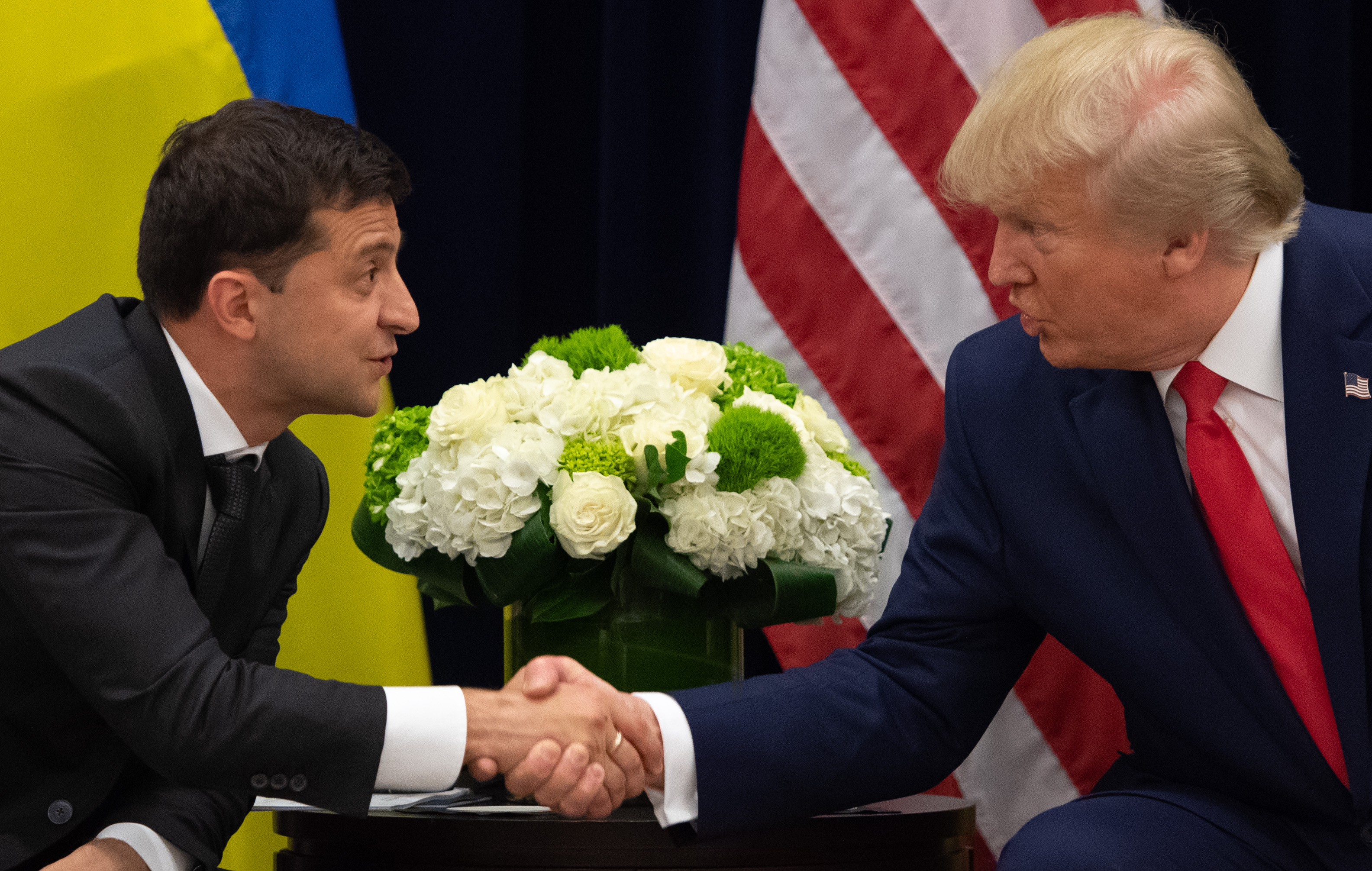 TOPSHOT - US President Donald Trump and Ukrainian President Volodymyr Zelensky shake hands during a meeting in New York on September 25, 2019, on the sidelines of the United Nations General Assembly. (Photo by SAUL LOEB/AFP/Getty Images)