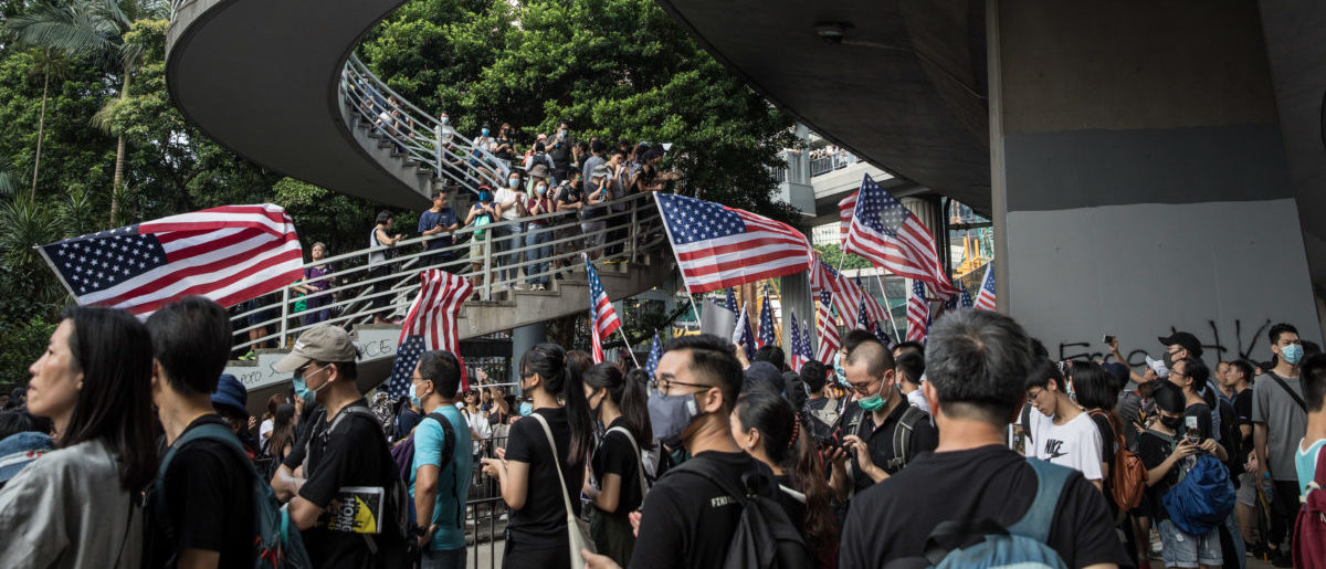 HONG KONG, CHINA - SEPTEMBER 08: Tens of thousands of protesters walk through Central district during a march to petition the US Consulate in Hong Kong, China. (Photo by Chris McGrath/Getty Images)