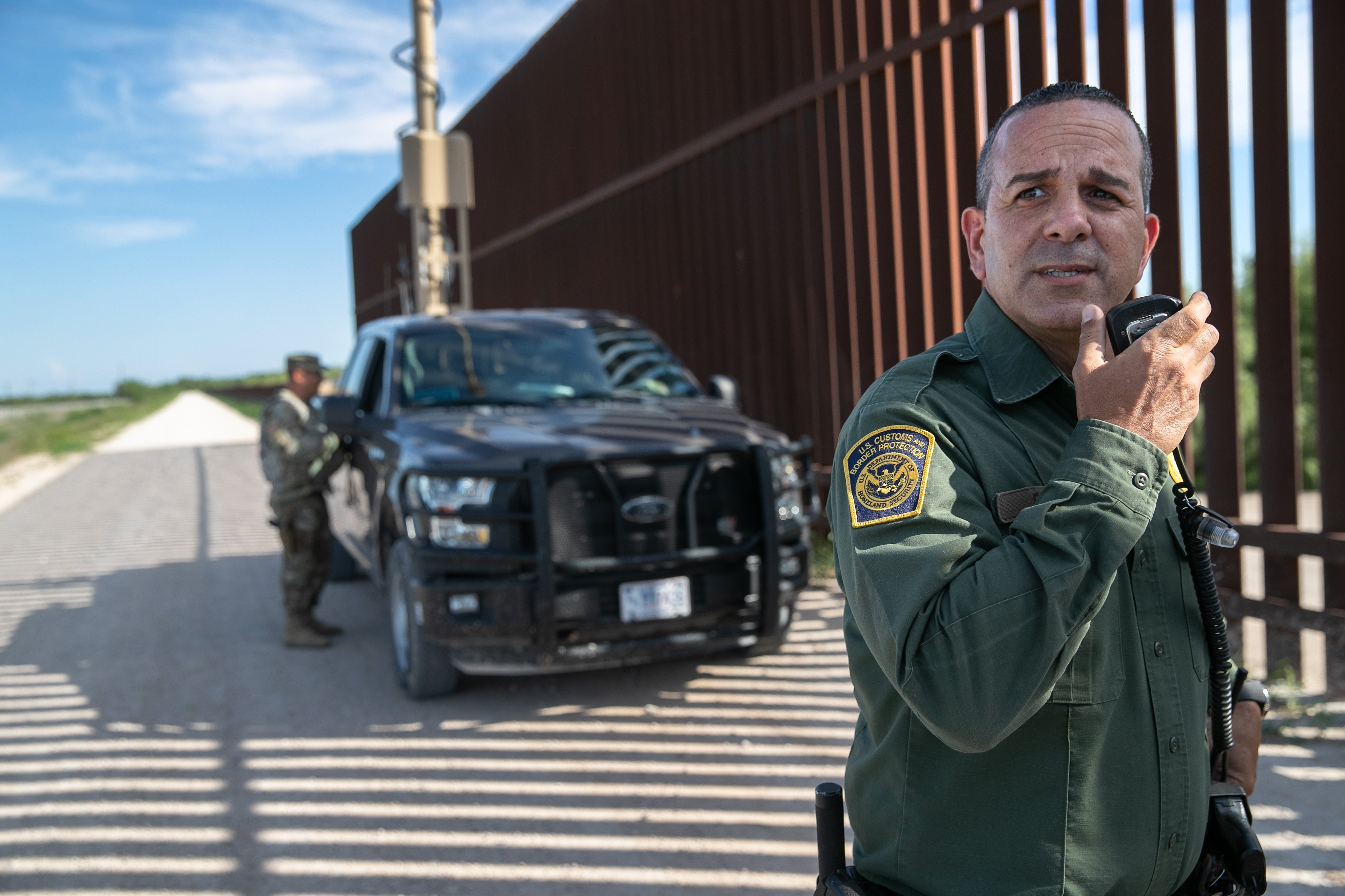 PENITAS, TEXAS - SEPTEMBER 10: U.S. Border Patrol agent Carlos Ruiz spots a pair of undocumented immigrants while coordinating with active duty U.S. Army soldiers near the U.S.-Mexico border fence on September 10, 2019 in Penitas, Texas. U.S. military personnel deployed to the border assist U.S. Border Patrol agents with surveillance, although the soldiers are not authorized to detain immigrants themselves. (Photo by John Moore/Getty Images)