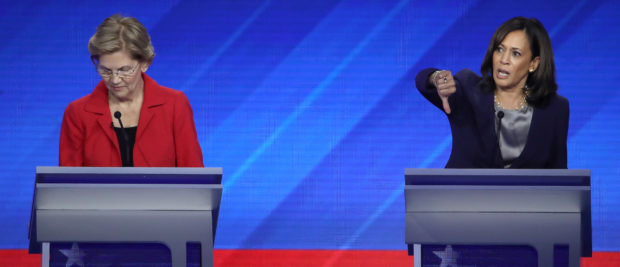 Democratic presidential candidates Elizabeth Warren and Kamala Harris interact on stage during the Democratic presidential debate at Texas Southern University's Health and PE Center on Sept, 12, 2019 in Houston, Texas. (Win McNamee/Getty Images)