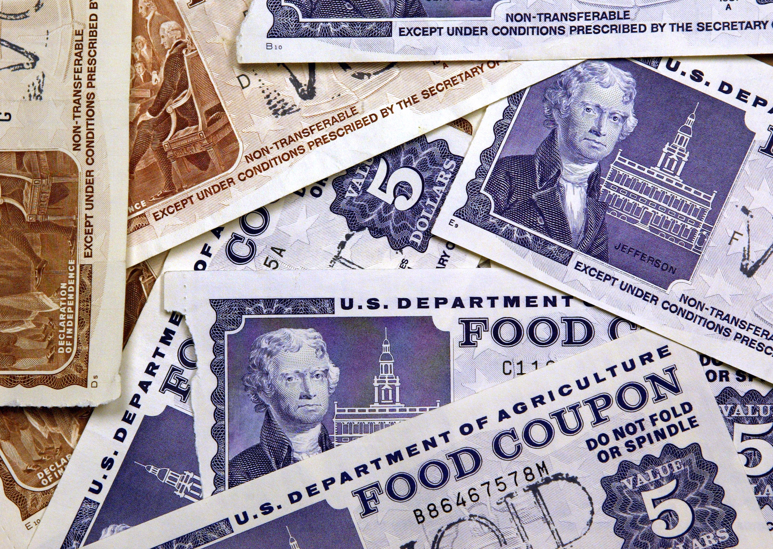 SKOKIE, IL - JUNE 24: Older, traditional food stamps are displayed June 24, 2004 at an Illinois Department of Human Services office in Skokie, Illinois. Agriculture Secretary Ann M. Veneman has announced all 50 states and the U.S. territories now provide Food Stamp Program benefits with EBT (Electronic Benefits Transfer) cards instead of the traditional paper coupon stamps. (Photo by Tim Boyle/Getty Images)