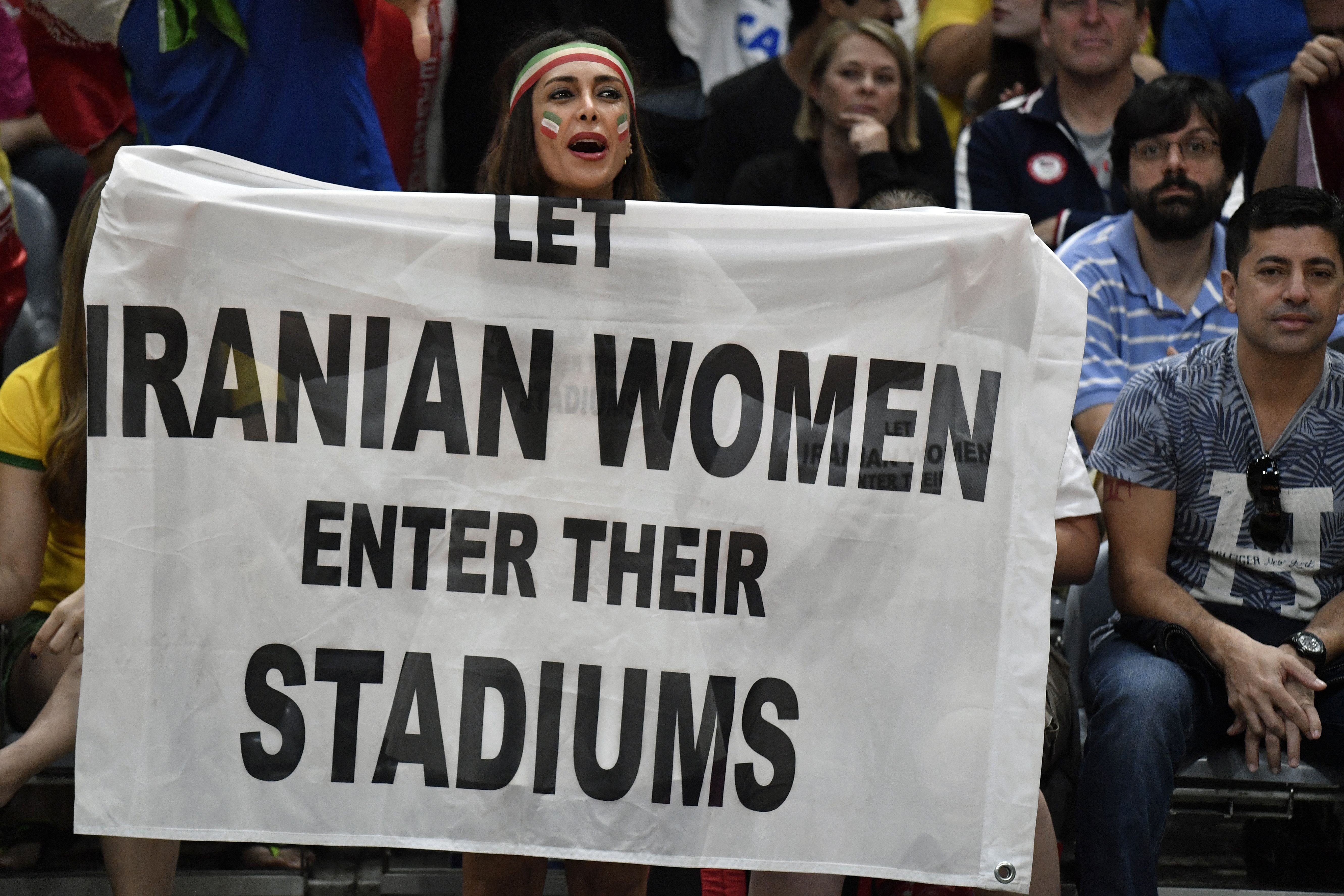 Iran supporters attend the men's qualifying volleyball match between Iran and Egypt at the Maracanazinho stadium in Rio de Janeiro on August 13, 2016, during the Rio 2016 Olympic Games. / AFP / PHILIPPE LOPEZ (Photo credit should read PHILIPPE LOPEZ/AFP/Getty Images)
